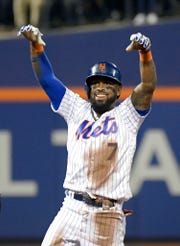 New York Mets shortstop Jose Reyes (7) reacts after hitting a double during the first inning of a baseball game against the Miami Marlins, Saturday, Sept. 29, 2018, in New York