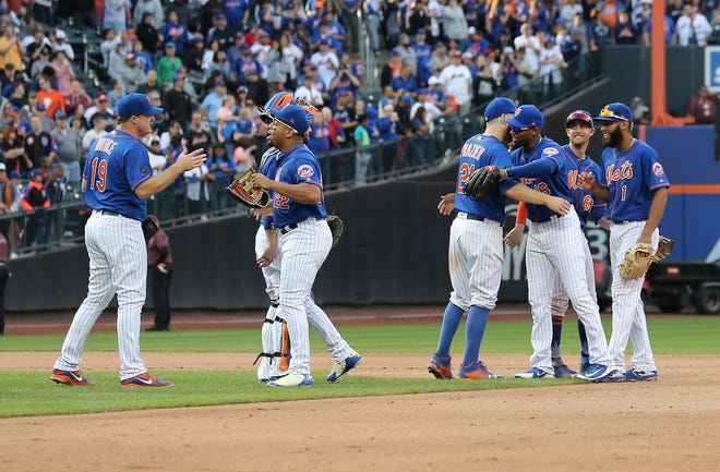 Sep 30, 2018; New York City, NY, USA; The New York Mets react after defeating the Miami Marlins at Citi Field.