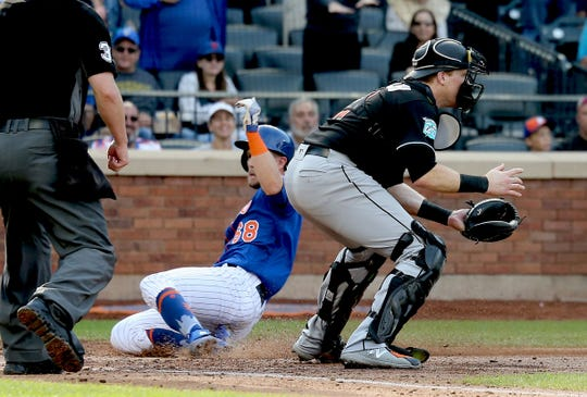 Sep 30, 2018; New York City, NY, USA; New York Mets second baseman Jeff McNeil (68) scores on an RBI double by third baseman Todd Frazier (not pictured) against the Miami Marlins during the fourth inning at Citi Field.