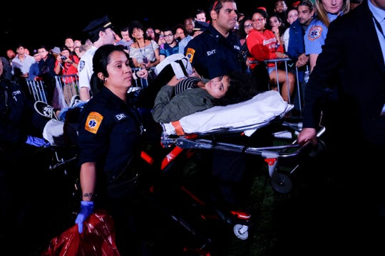 An injured concert goer gets carried away for medical attention after a barricade was knocked over at the 2018 Global Citizen Festival in Central Park on Saturday, Sept. 29, 2018, in New York. (Photo by Evan Agostini/Invision/AP)