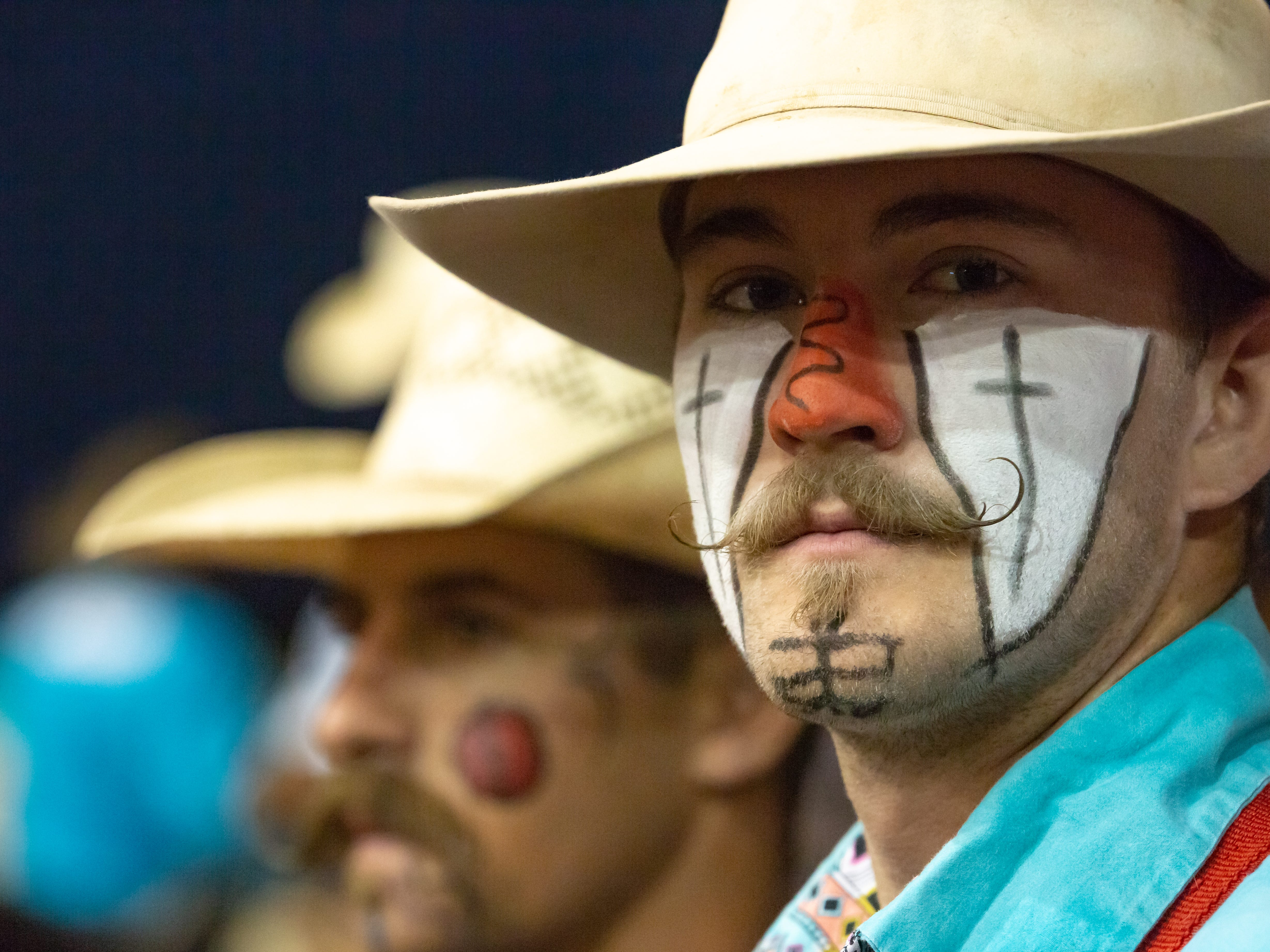 Professional bull fighter Ethan Johnson, of Corona, New Mexico, is pictured with his face painted in the Pete V. Domenici Arena on Saturday, Sept. 29, 2018, during the Southern New Mexico State Fair & Rodeo at the Southern New Mexico State Fairgrounds.