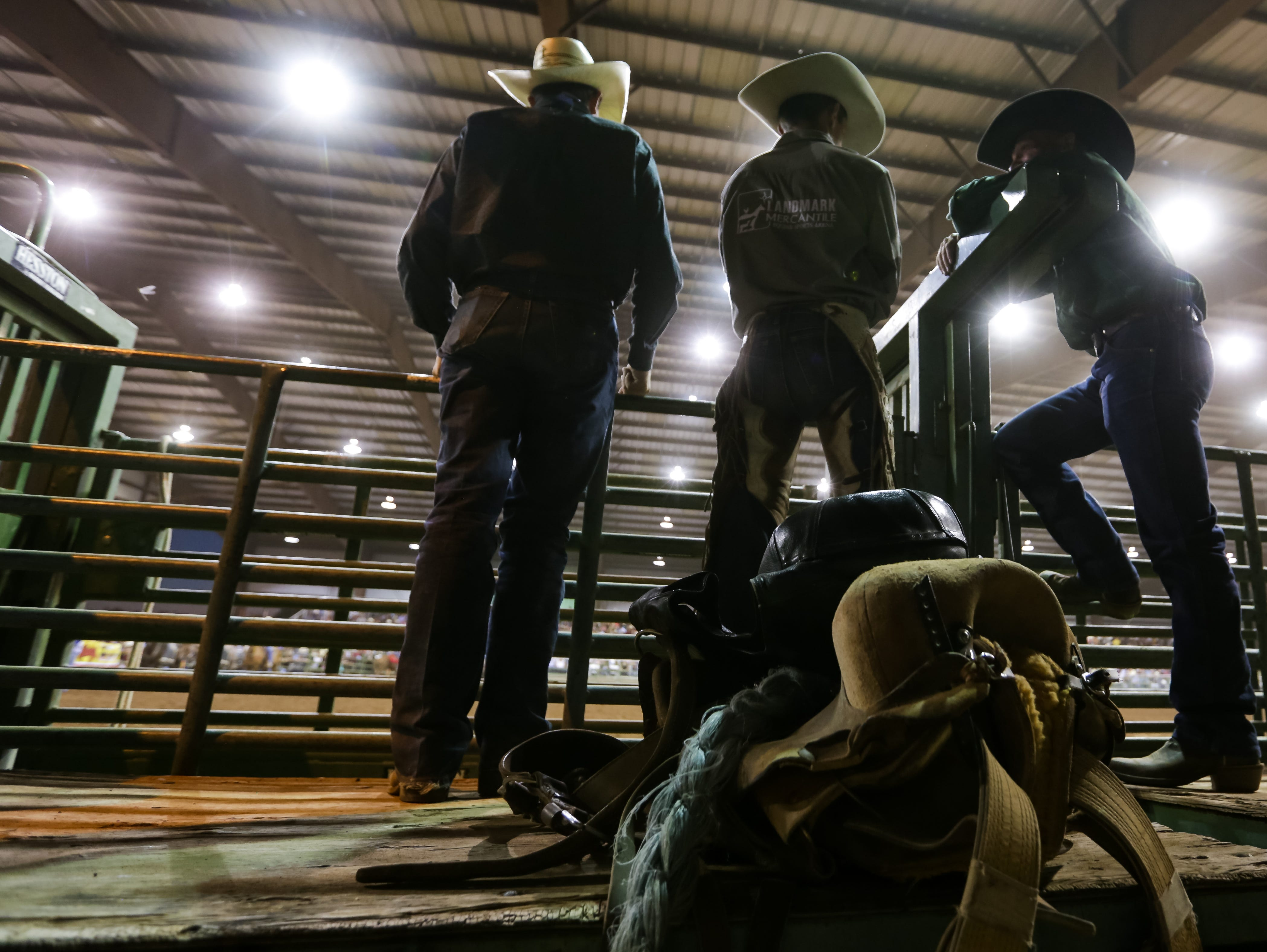 Cowboys watch the events in the Pete V. Domenici Arena on Saturday, Sept. 29, 2018, during the Southern New Mexico State Fair & Rodeo at the Southern New Mexico State Fairgrounds.