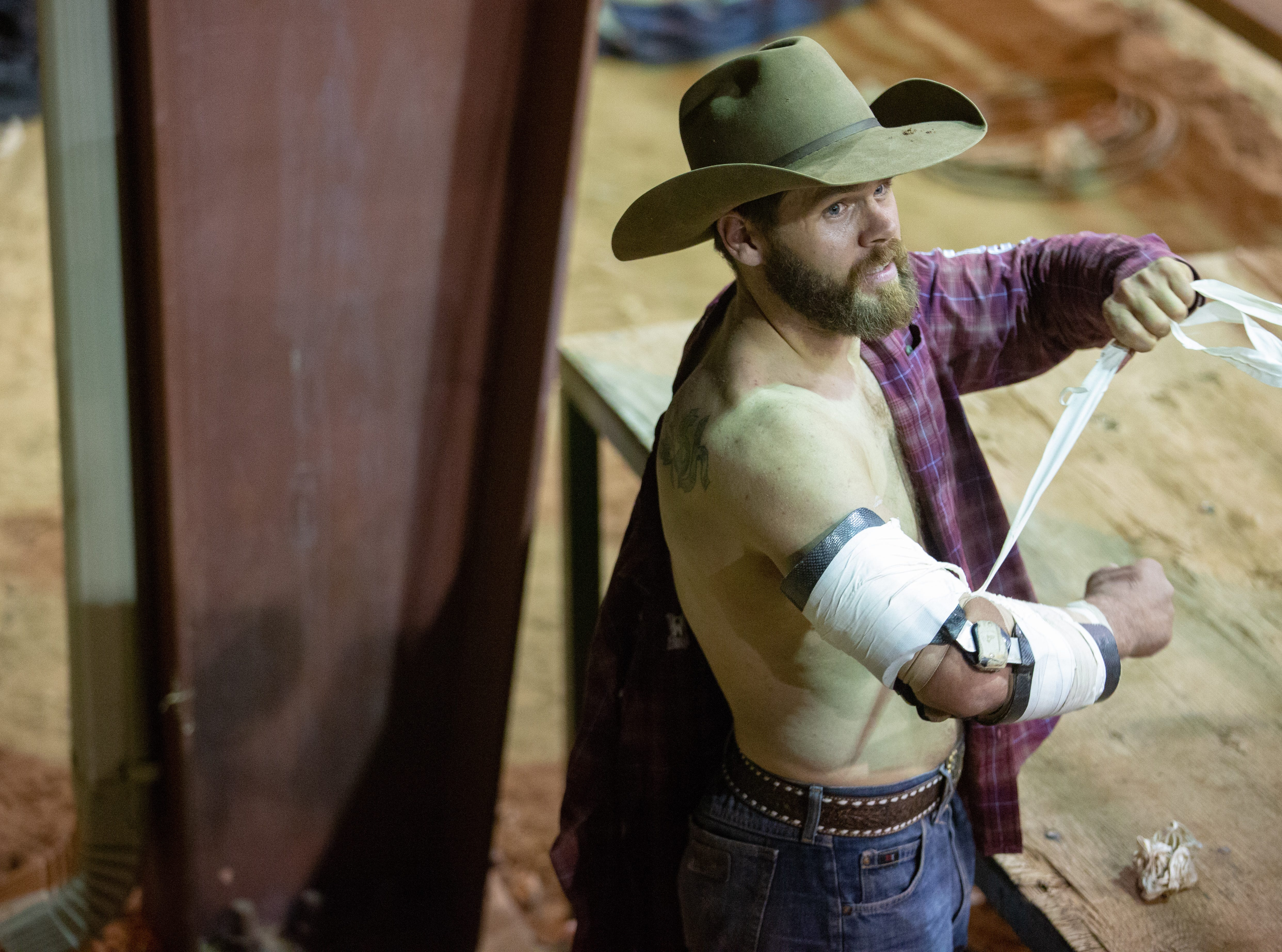 Luke Creasy, of Hobbs, New Mexico, unwraps his arm on on Saturday, Sept. 29, 2018, during the Southern New Mexico State Fair & Rodeo at the Southern New Mexico State Fairgrounds.