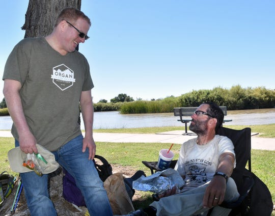 New Mexico Sen. Jeff Steinborn, D-Las Cruces, greets Pete Livingstone, right, after the hiker arrives at La Llorona Park Sunday, Sept. 23, 2018. Steinborn was instrumental in the designation of the Rio Grande Trail and Livingstone in September helped scout locations along the 500-mile route.