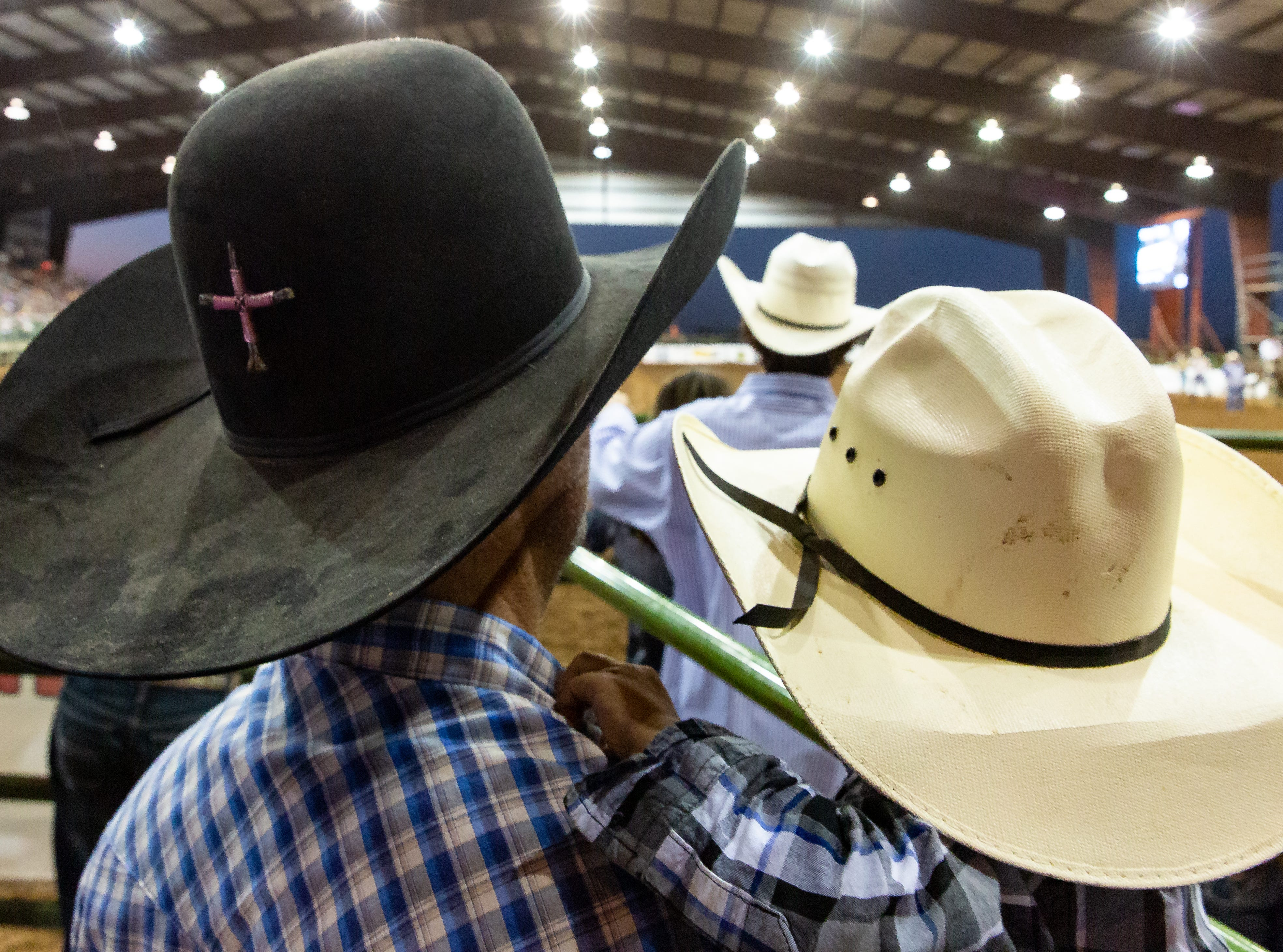 BJ Kane and his son Enoch Kane, 1-year-old, both of Las Cruces, watch the events in the Pete V. Domenici Arena on Saturday, Sept. 29, 2018, during the Southern New Mexico State Fair & Rodeo at the Southern New Mexico State Fairgrounds.
