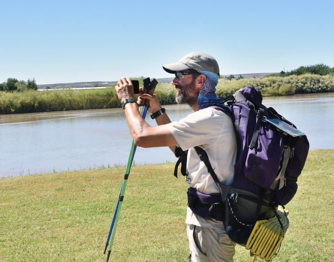 Pete Livingstone stops along the banks of the Rio Grande near La Llorona Park on Sunday, Sept. 23, 2018, to take pictures and document his trip exploring the 500-mile Rio Grande Trail.