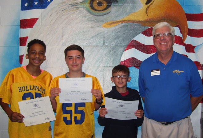 Holloman Middle School pictured left to right: Holloman students Shawn Stubblefield, Brenden Riker and Alex Smereka with Kiwanis Club member Ned Kline.