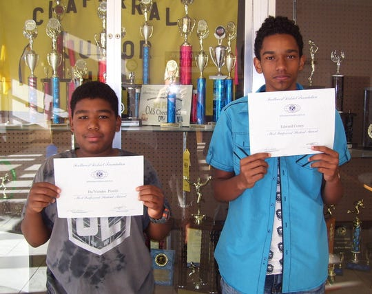 Chaparral Middle School pictured left to right: Chaparral Middle students Da'Vondre Pistilli and Edward Coney. Student Rudy Lueras was unavailable for the photo.