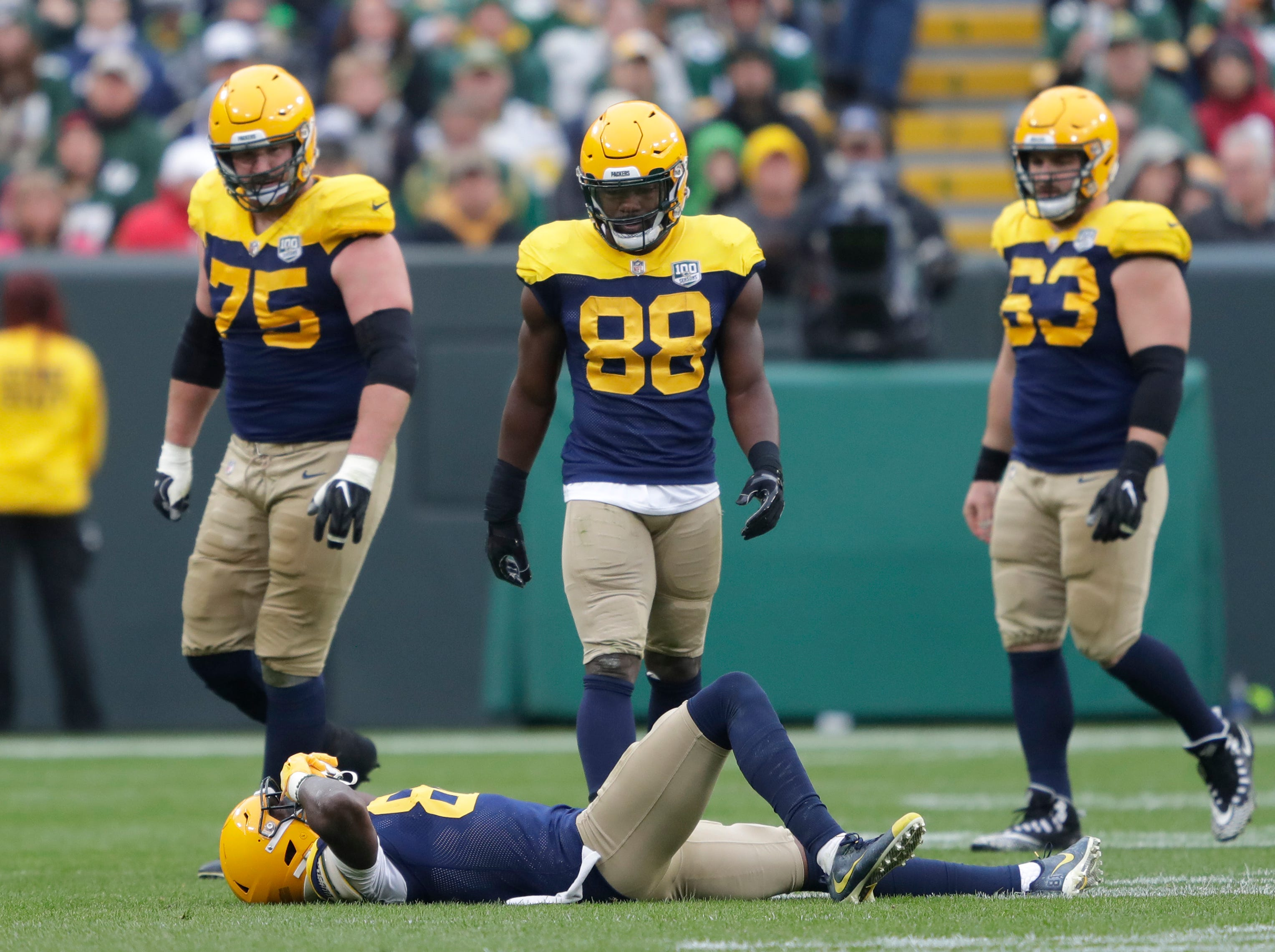 Green Bay Packers wide receiver Geronimo Allison (81) lies on the ground after getting injured from a hit in the third quarter during their football game Sunday, Sept. 30, 2018, at Lambeau Field in Green Bay, Wis. 