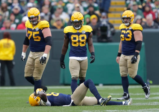 Green Bay Packers wide receiver Geronimo Allison (81) lies on the ground after getting injured from a hit in the third quarter during their football game Sunday, Sept. 30, 2018, at Lambeau Field in Green Bay, Wis. Dan Powers/USA TODAY NETWORK-Wisconsin