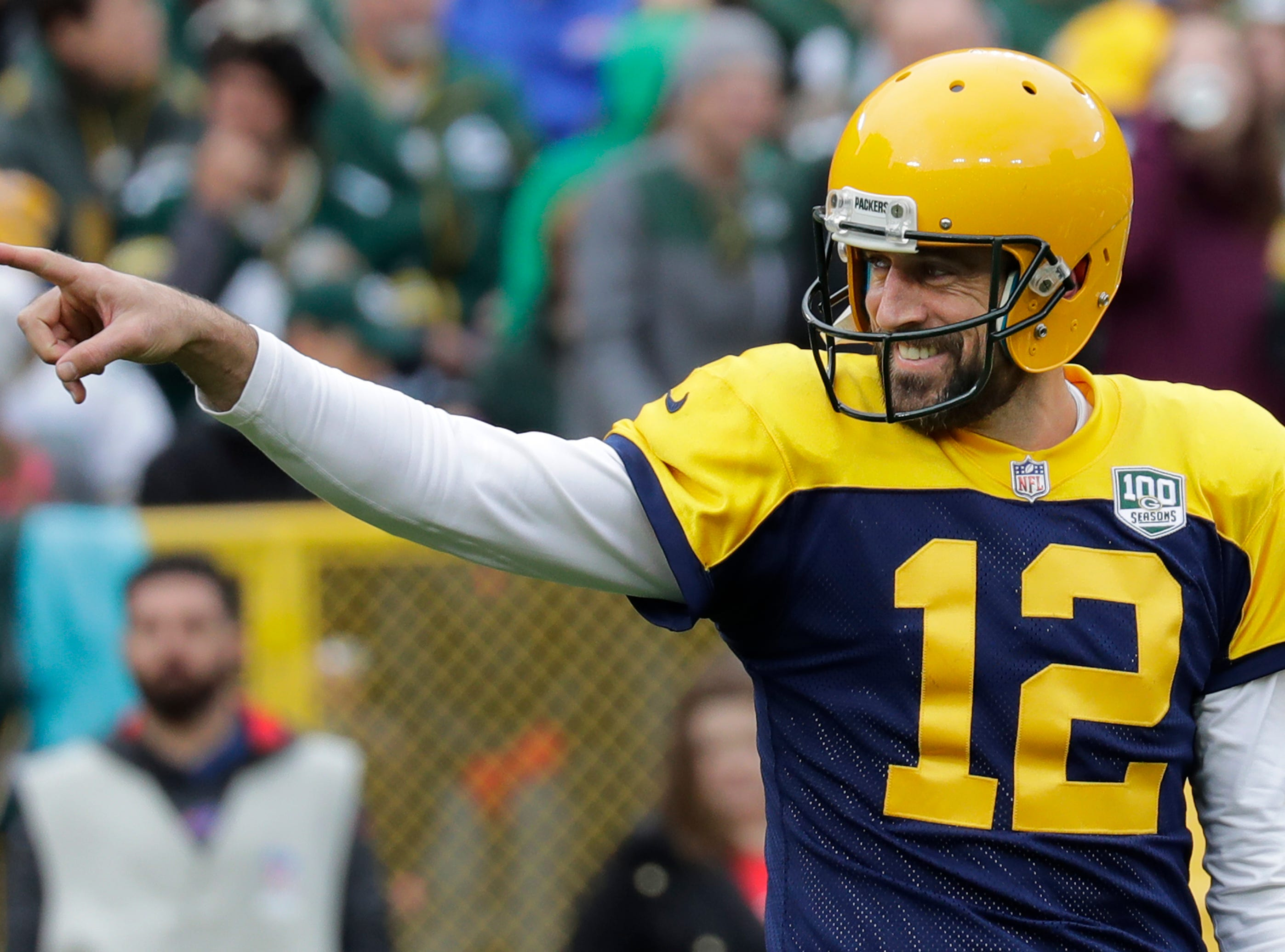 Green Bay Packers quarterback Aaron Rodgers (12) smiles as he points to a vocal group of fans that caught his attention late in the fourth quarter against the Buffalo Bills during their football game Sunday, Sept. 30, 2018, at Lambeau Field in Green Bay, Wis. 