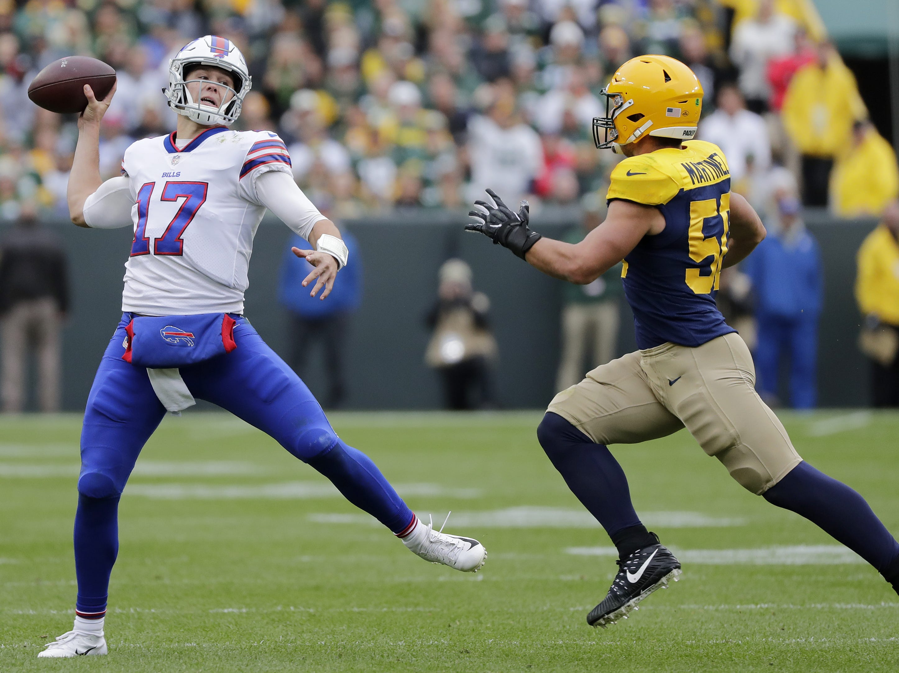 Buffalo Bills quarterback Josh Allen (17) throws an interception under pressure from Green Bay Packers linebacker Blake Martinez (50) in the second quarter at Lambeau Field on Sunday, September 30, 2018 in Green Bay, Wis. Adam Wesley/USA TODAY NETWORK-Wisconsin