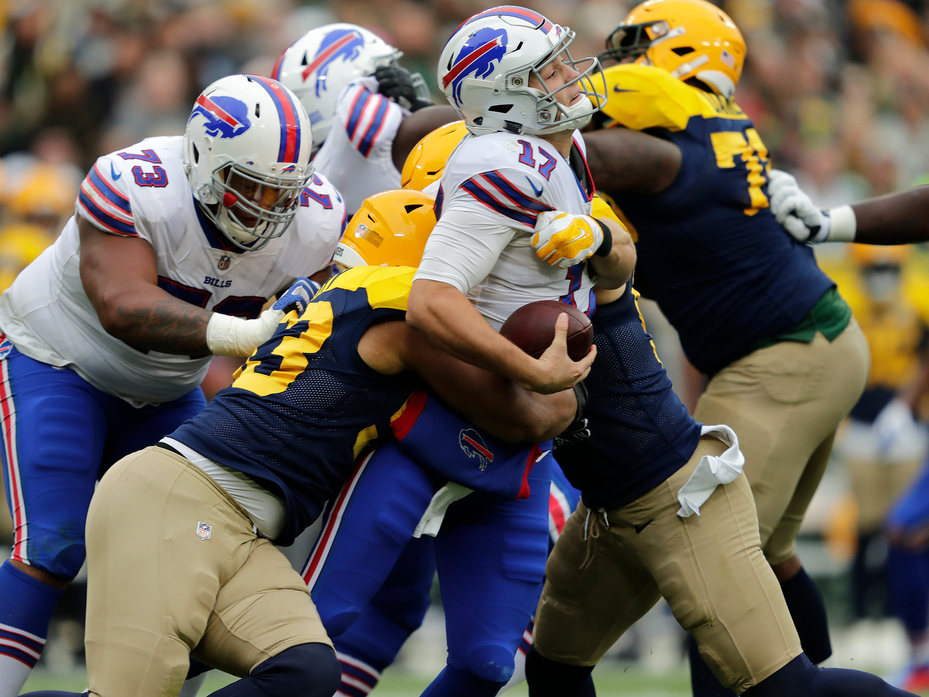 Green Bay Packers linebacker Nick Perry (53), left, and linebacker Clay Matthews (52) sack Buffalo Bills quarterback Josh Allen (17) in the second quarter during their football game Sunday, Sept. 30, 2018, at Lambeau Field in Green Bay, Wis. 