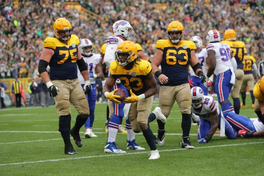Green Bay Packers running back Aaron Jones (33) scores  a touchdown during the second quarter of the Green Bay Packers game against the Buffalo Bills at Lambeau Field in Green Bay, Wis. on Sunday, September 30, 2018.