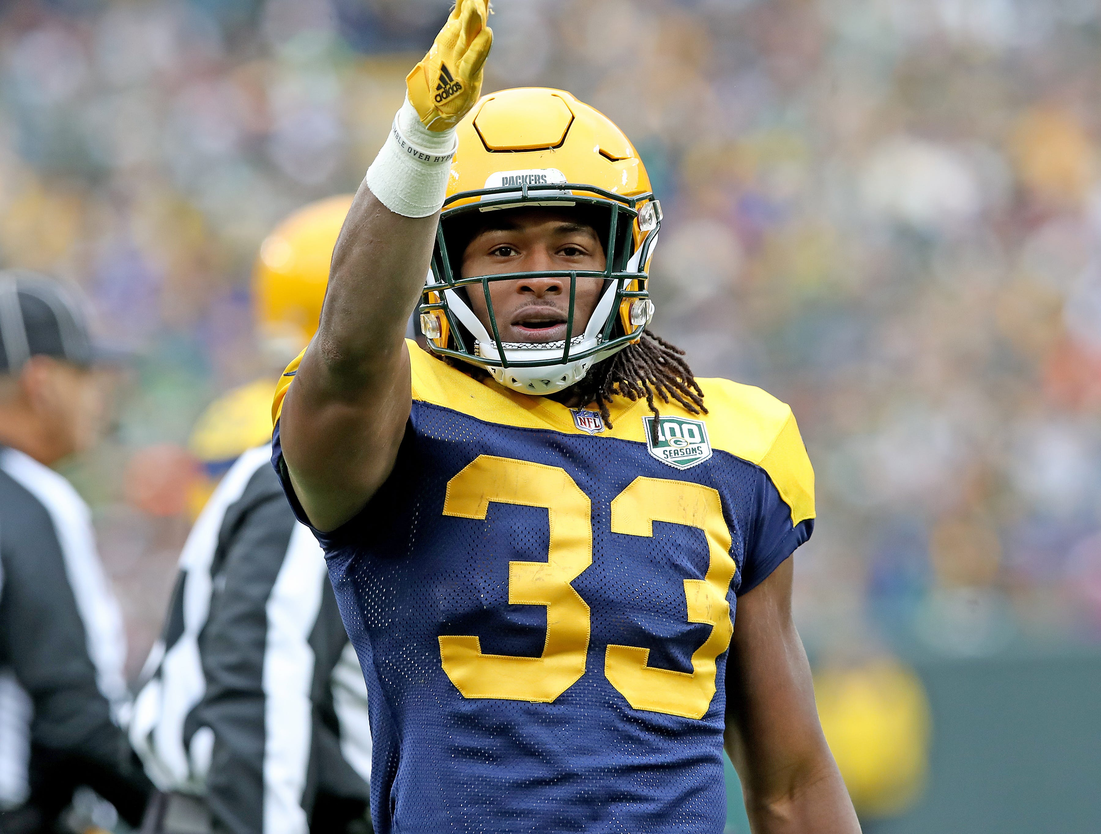 Green Bay Packers running back Aaron Jones (33) signals first down after a run against the Buffalo Bills Sunday September 30, 2018 at Lambeau Field in Green Bay, Wis.