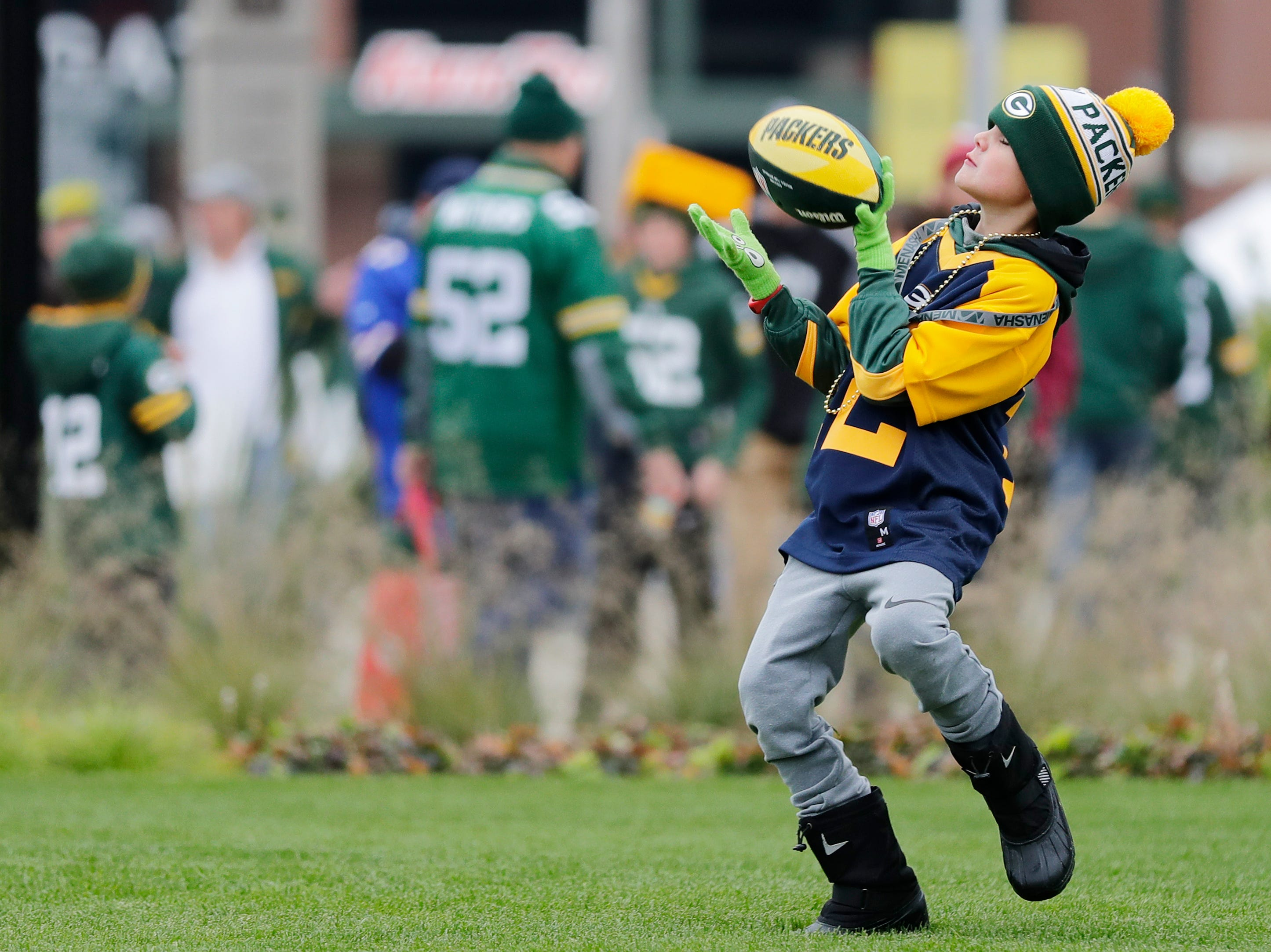 Jace Meyers, 7, of Milwaukee plays catch outside Lambeau Field on Sunday, September 30, 2018 in Green Bay, Wis.