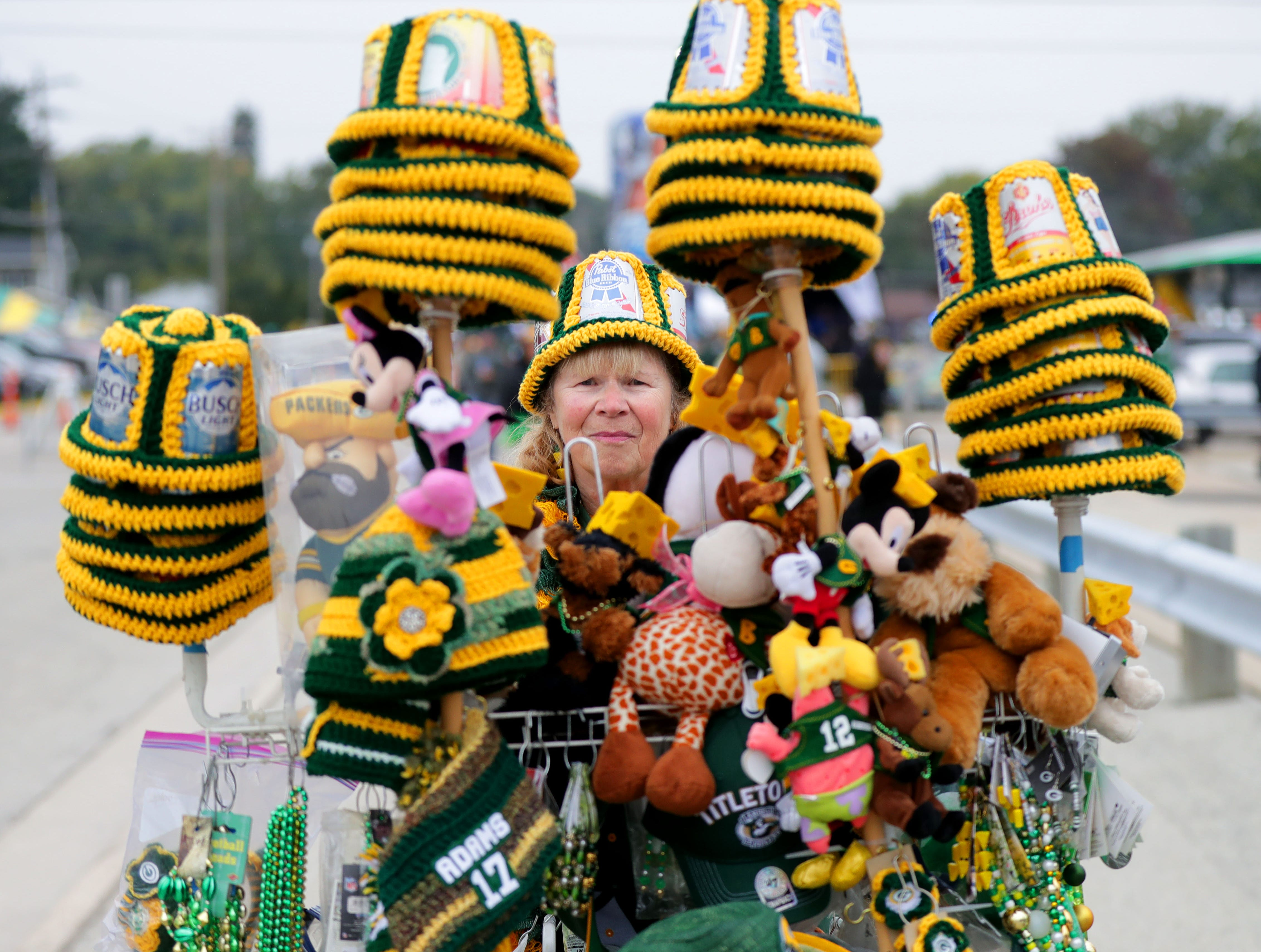 Sharon Meyer sells crochet Packers hats before the Green Bay Packers game against the Buffalo Bills at Lambeau Field in Green Bay, Wis. on Sunday, September 30, 2018.