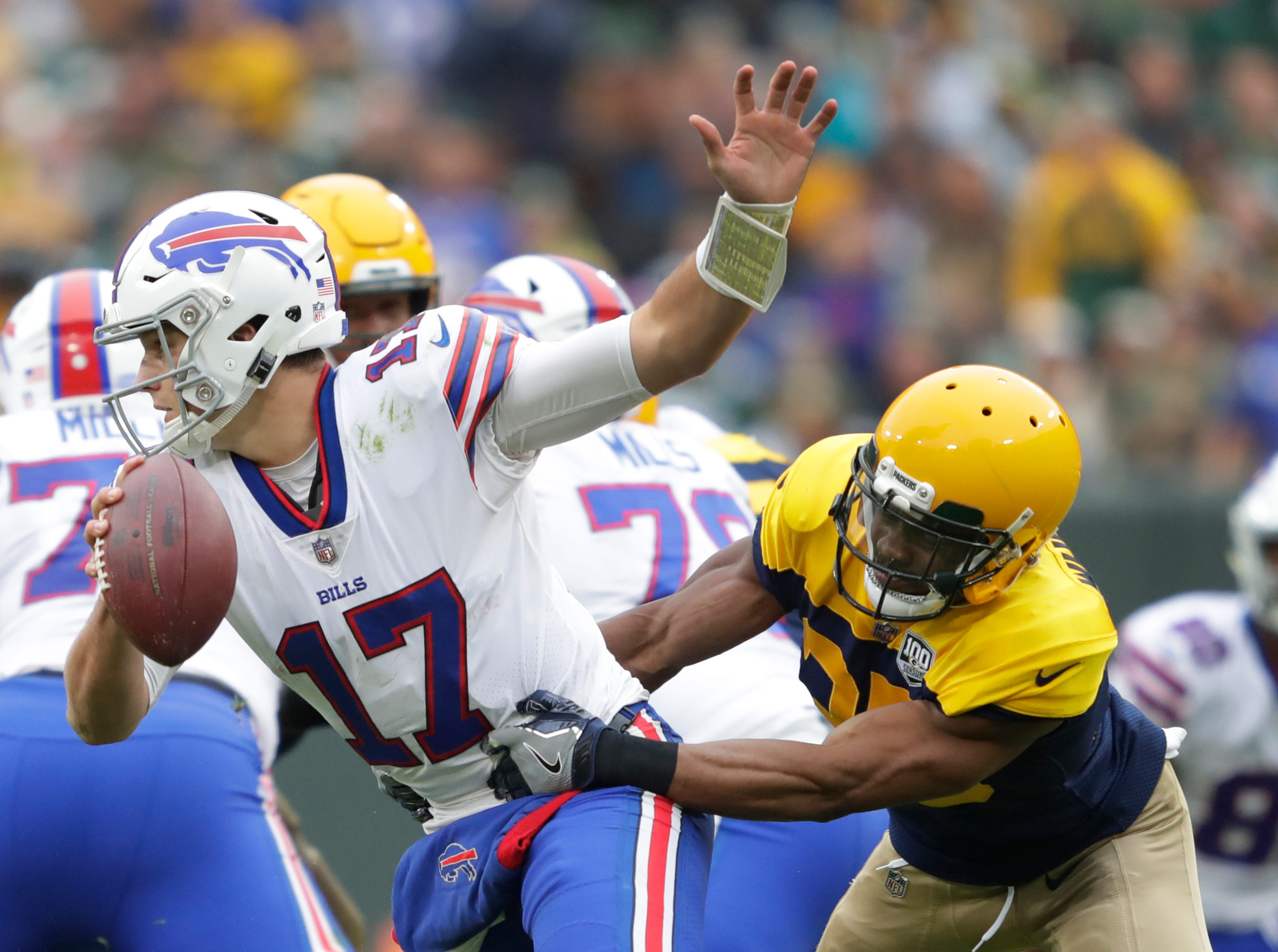 Green Bay Packers defensive back Jermaine Whitehead (35) sacks Buffalo Bills quarterback Josh Allen (17) in the third quarter during their football game Sunday, Sept. 30, 2018, at Lambeau Field in Green Bay, Wis. 