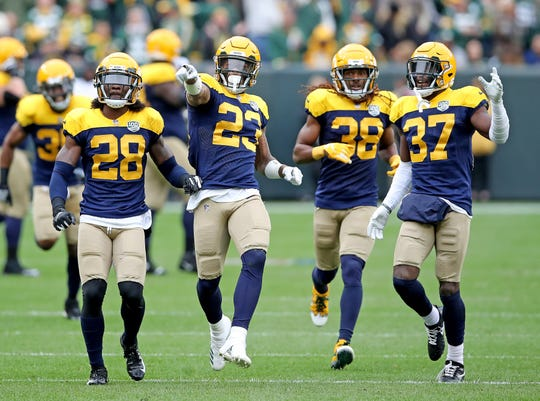 Green Bay Packers cornerback Jaire Alexander (23) points to the crowd as he celebrates his interception with his teammates against the Buffalo Bills Sunday September 30, 2018 at Lambeau Field in Green Bay, Wis.