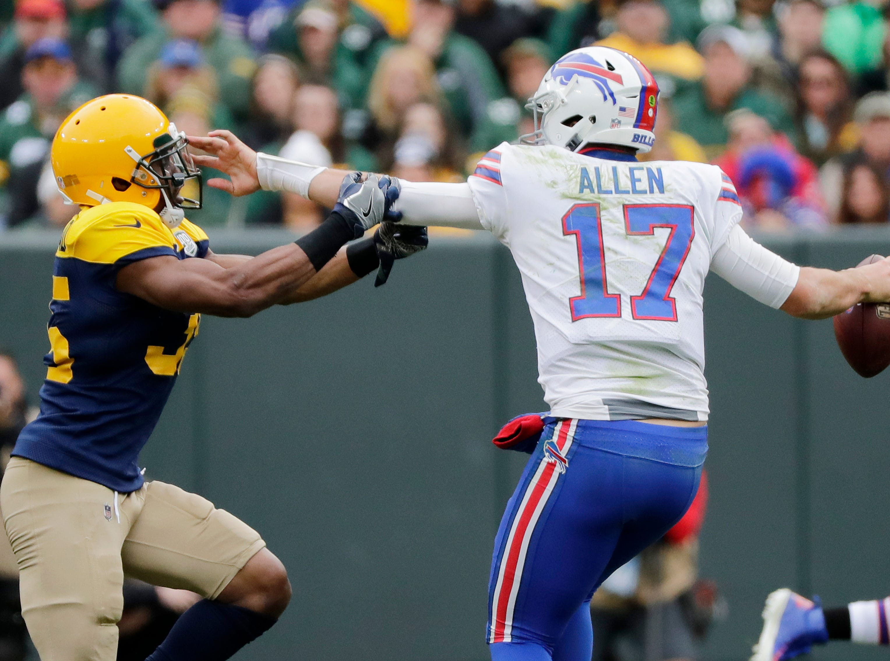 Buffalo Bills quarterback Josh Allen (17) is pressured by Green Bay Packers defensive back Jermaine Whitehead (35) in the fourth quarter at Lambeau Field on Sunday, September 30, 2018 in Green Bay, Wis.