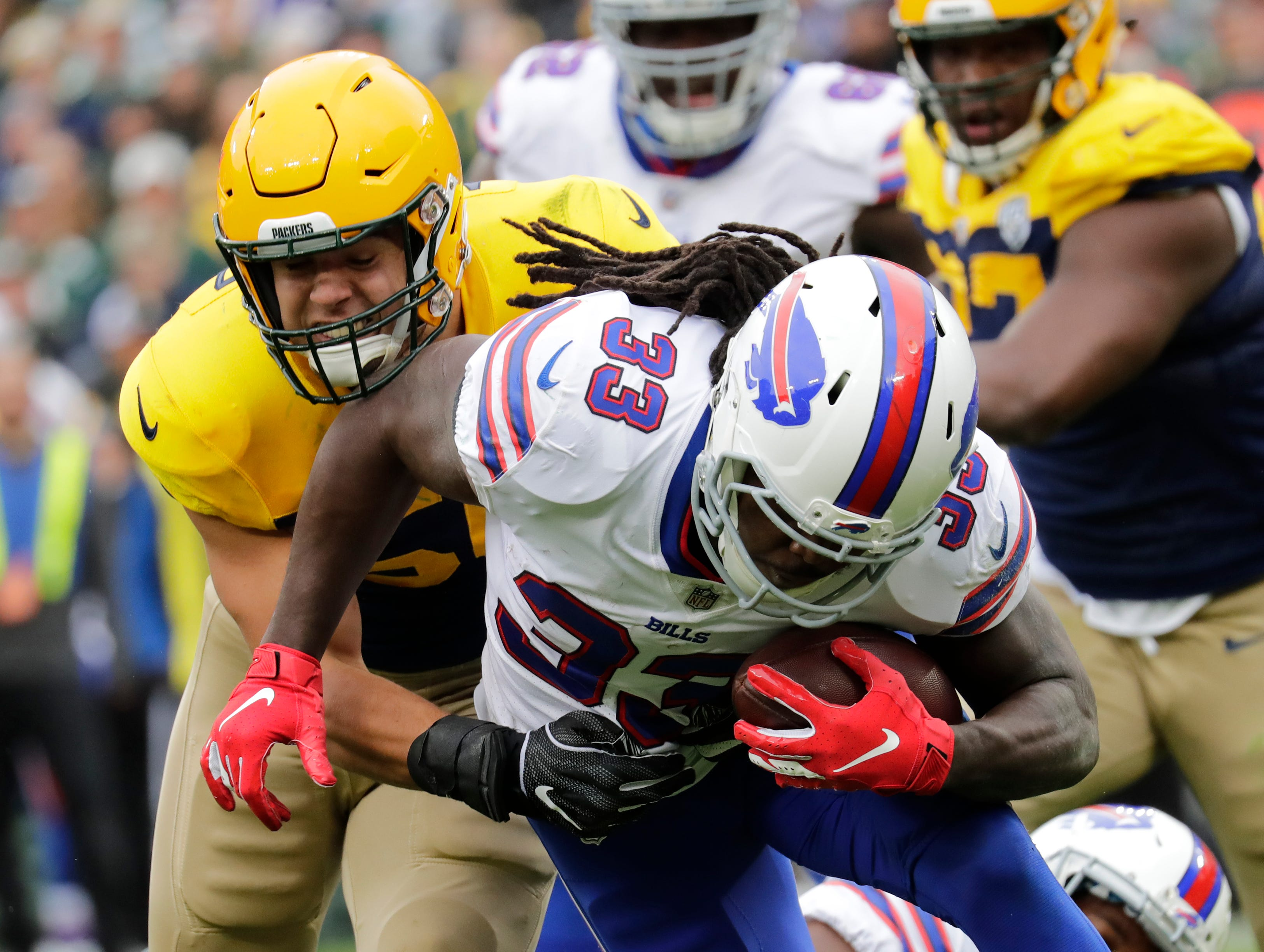 Green Bay Packers linebacker Blake Martinez (50) tackles Buffalo Bills running back Chris Ivory (33) in the secon quarter during their football game Sunday, Sept. 30, 2018, at Lambeau Field in Green Bay, Wis.