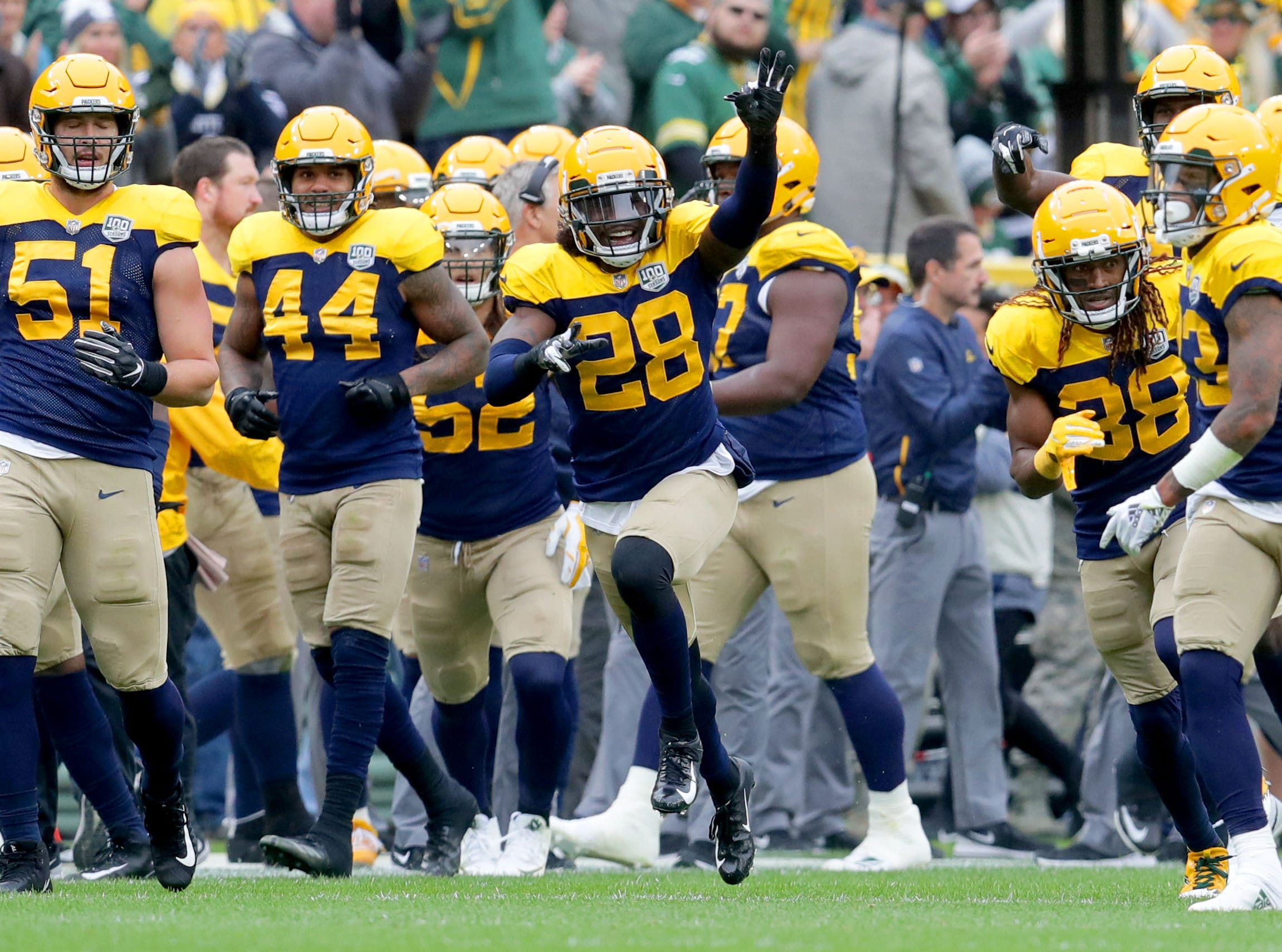 The Green Bay Packers defense celebrates an interception by Green Bay Packers cornerback Jaire Alexander (23) during the second quarter of the Green Bay Packers game against the Buffalo Bills at Lambeau Field in Green Bay, Wis. on Sunday, September 30, 2018. Mike De Sisti /USA TODAY NETWORK-Wisconsin