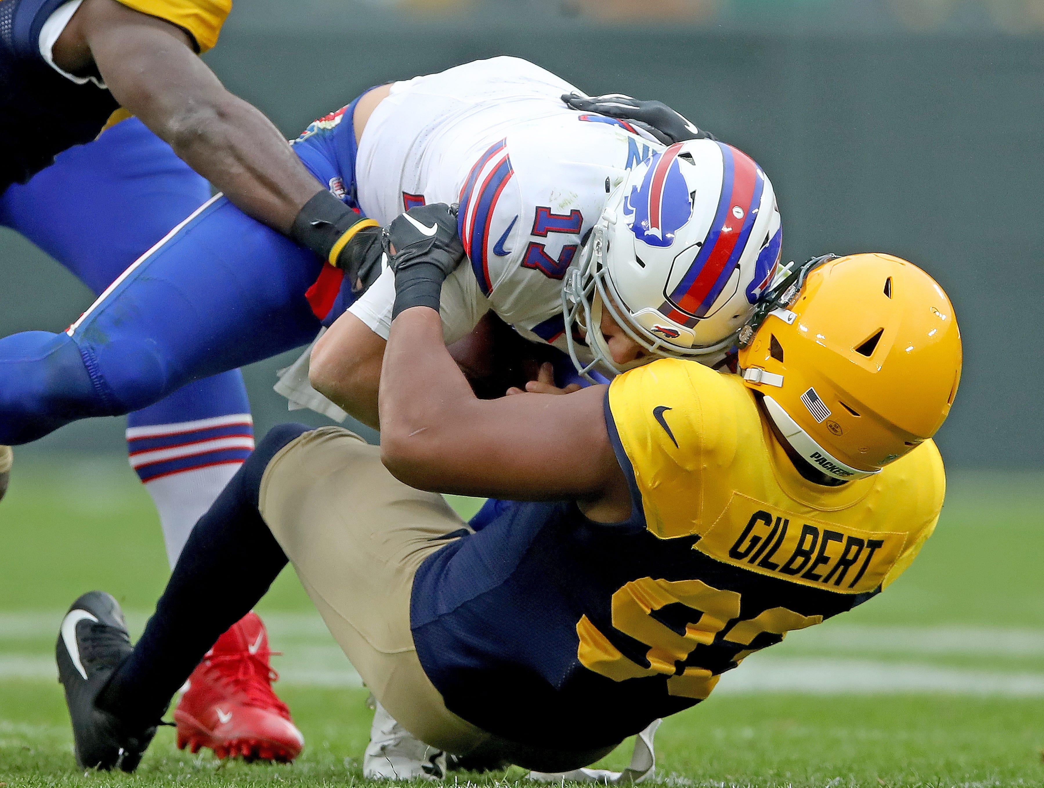 Green Bay Packers linebacker Reggie Gilbert (93) sacks quarterback Josh Allen (17) against the Buffalo Bills Sunday September 30, 2018 at Lambeau Field in Green Bay, Wis.