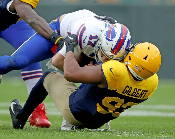 Green Bay Packers linebacker Reggie Gilbert (93) sacks quarterback Josh Allen (17) against the Buffalo Bills Sunday September 30, 2018 at Lambeau Field in Green Bay, Wis.