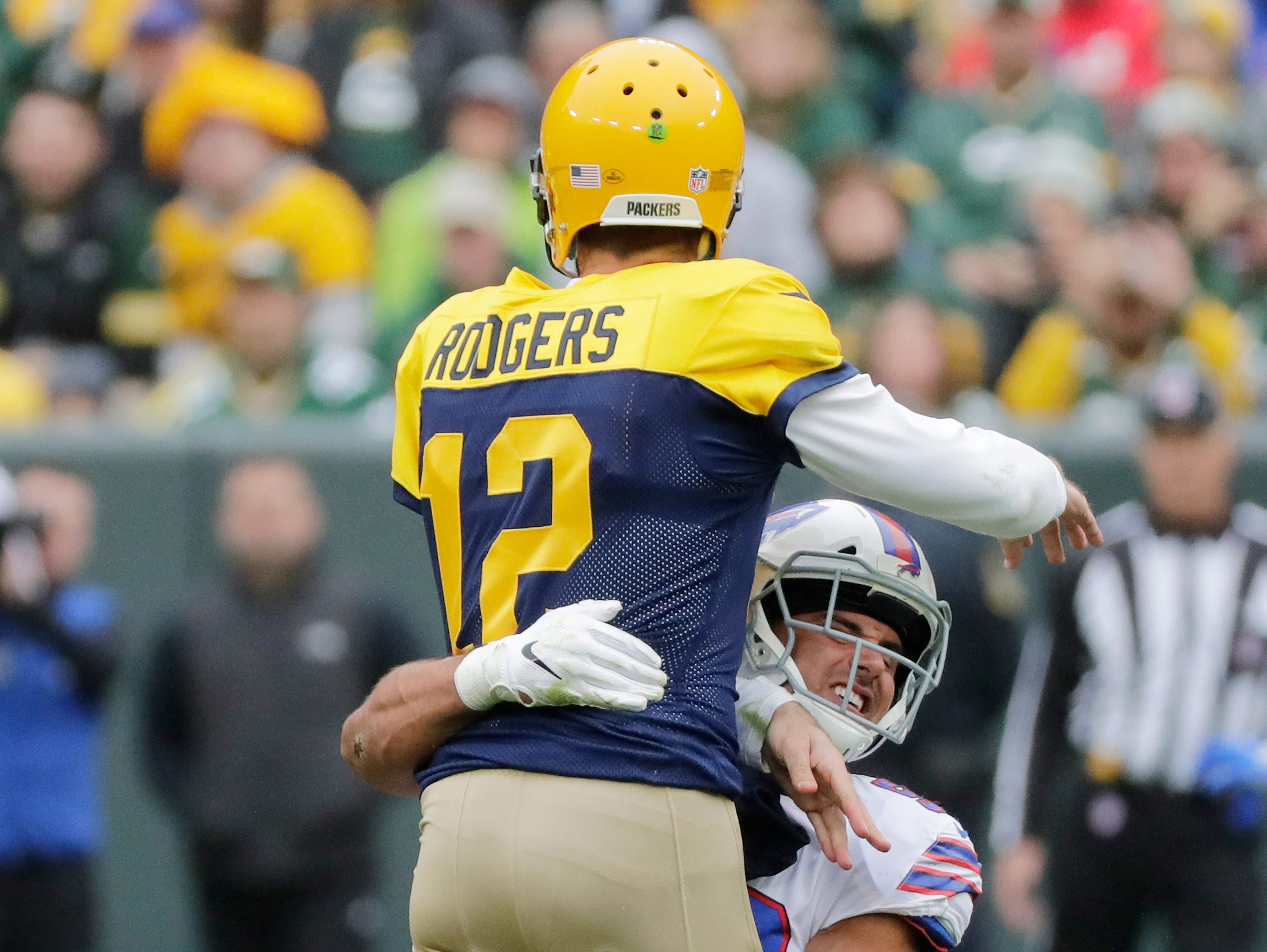 Green Bay Packers quarterback Aaron Rodgers (12) is hit by Buffalo Bills linebacker Matt Milano (58) in the third quarter at Lambeau Field on Sunday, September 30, 2018 in Green Bay, Wis.