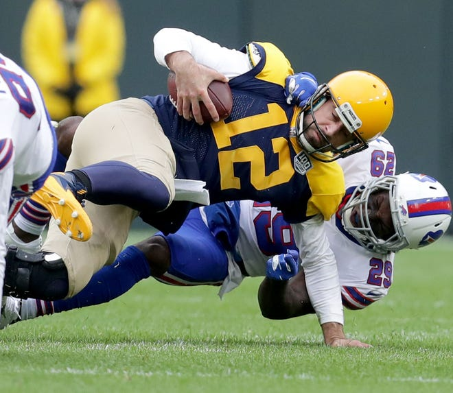 Green Bay Packers quarterback Aaron Rodgers (12) is sacked by Buffalo Bills defensive back Siran Neal (29) during the second quarter of the Green Bay Packers game against the Buffalo Bills at Lambeau Field in Green Bay, Wis. on Sunday, September 30, 2018. Mike De Sisti /USA TODAY NETWORK-Wisconsin