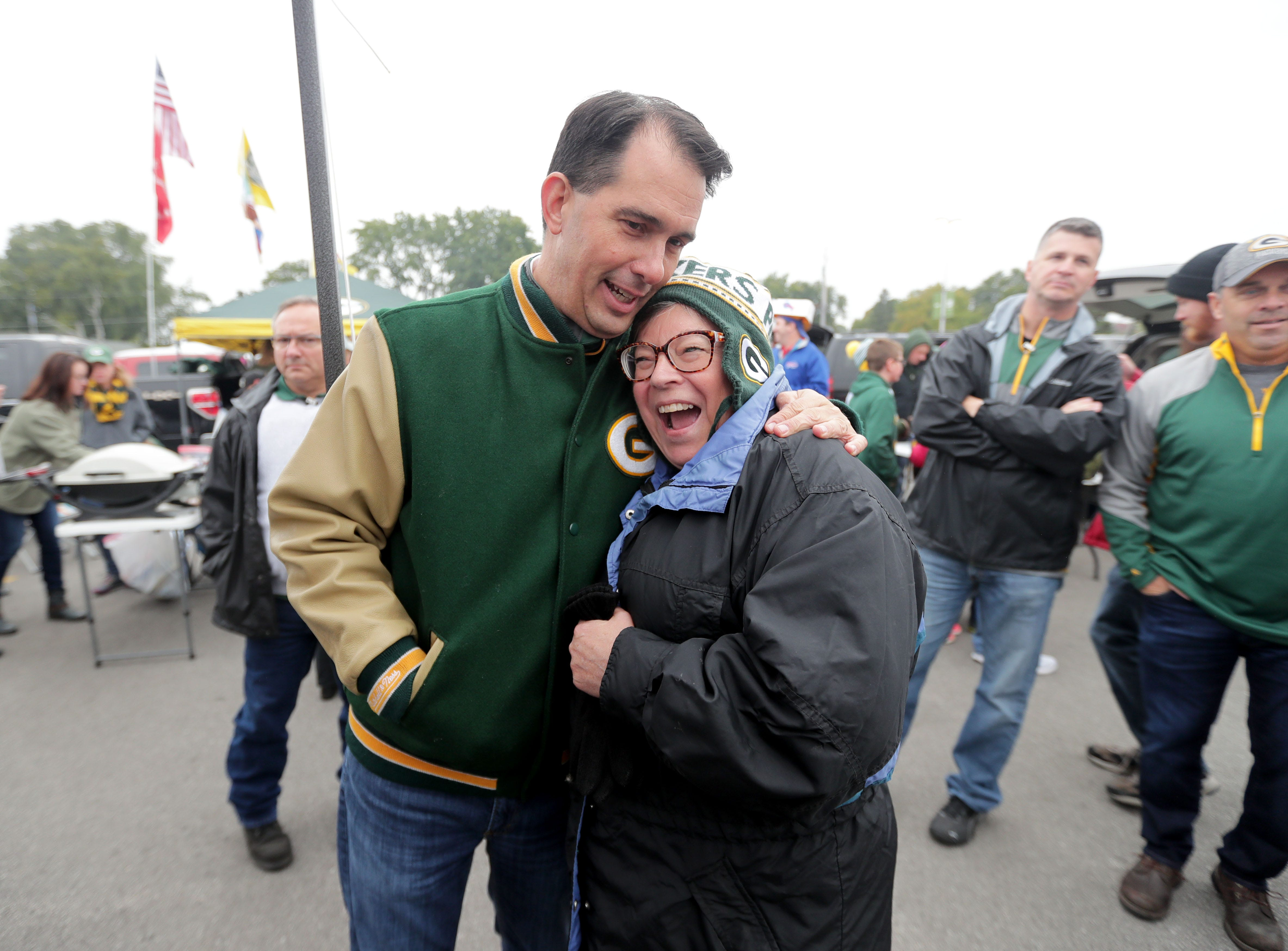 Gov. Scott Walker interacts with Mary Zimmerman of Green Bay before the Green Bay Packers game against the Buffalo Bills at Lambeau Field in Green Bay, Wis. on Sunday, September 30, 2018.