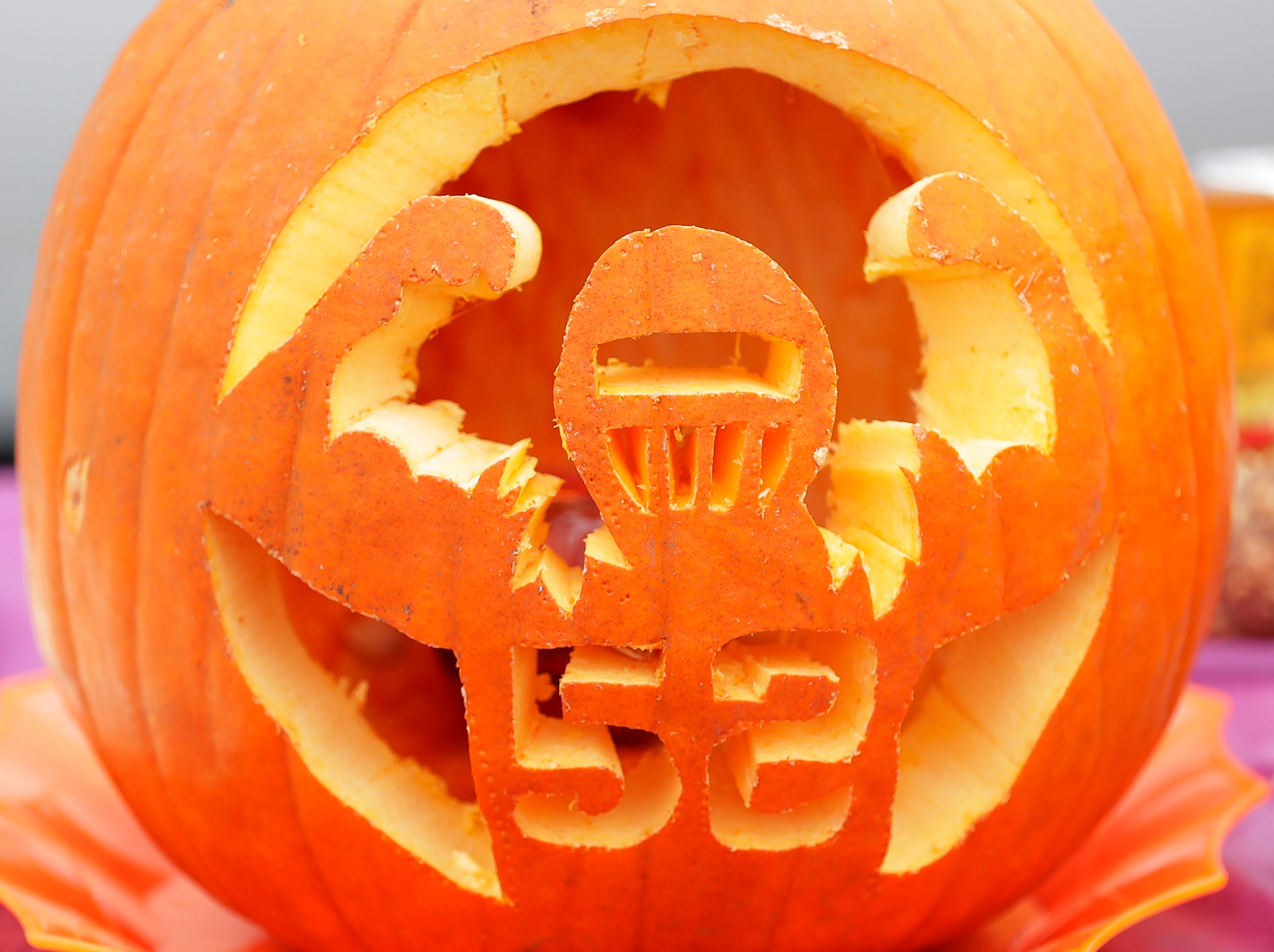A Packers-themed pumpkin is displayed at a tailgate at Lambeau Field on Sunday, September 30, 2018 in Green Bay, Wis.