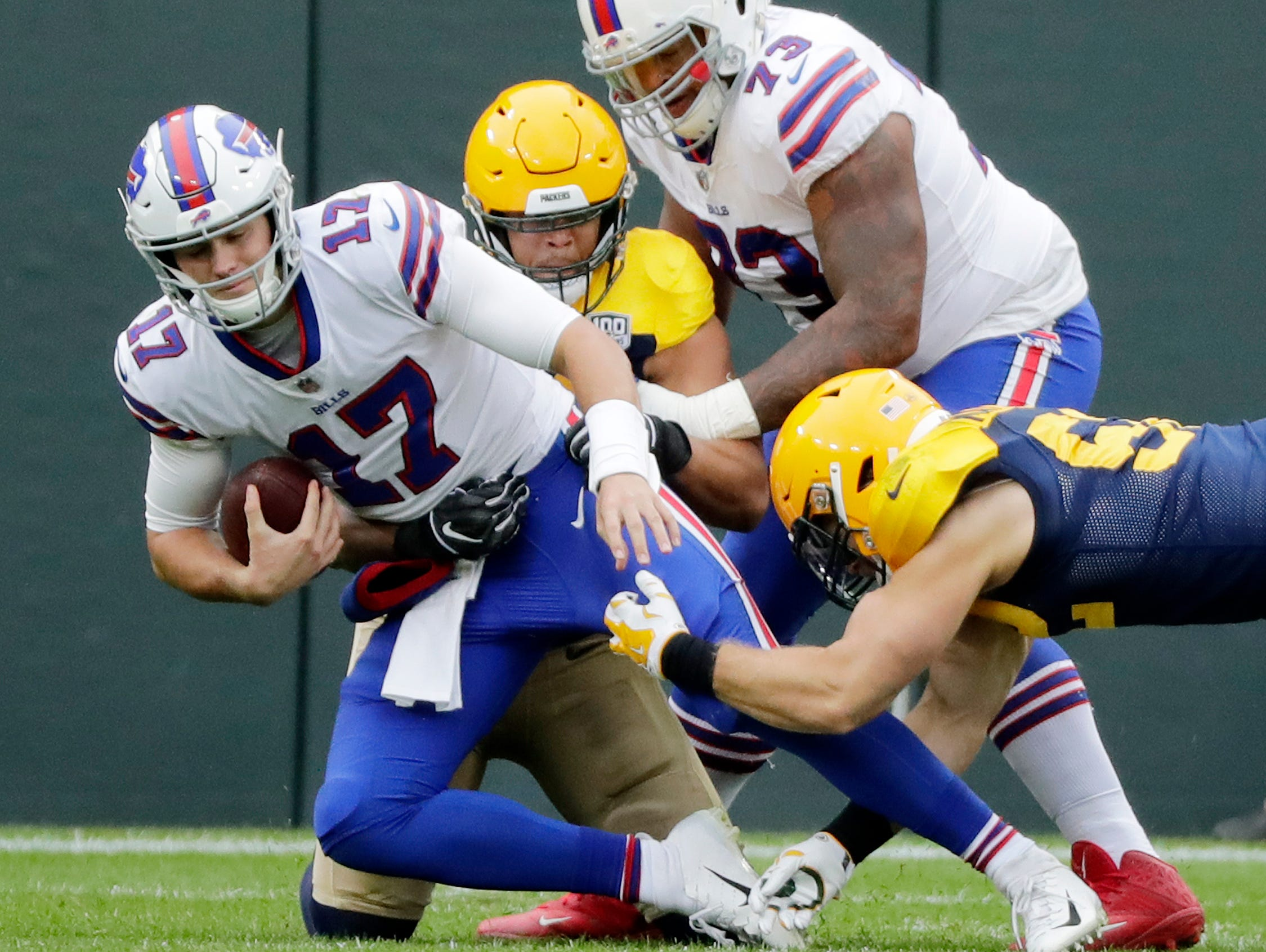 Green Bay Packers linebacker Clay Matthews (52) and linebacker Nick Perry (53) sack Buffalo Bills quarterback Josh Allen (17) in the first quarter at Lambeau Field on Sunday, September 30, 2018 in Green Bay, Wis.