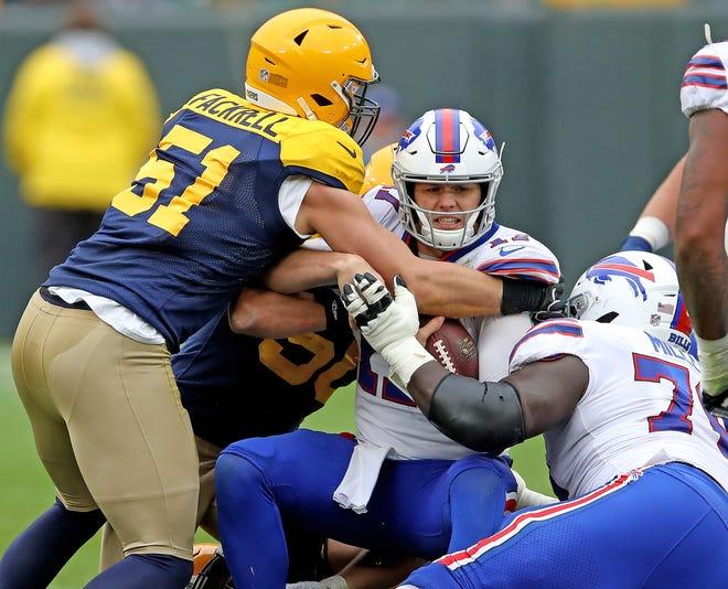 Green Bay Packers linebacker Kyler Fackrell (51) helps sack quarterback Josh Allen (17) against the Buffalo Bills Sunday September 30, 2018 at Lambeau Field in Green Bay, Wis.