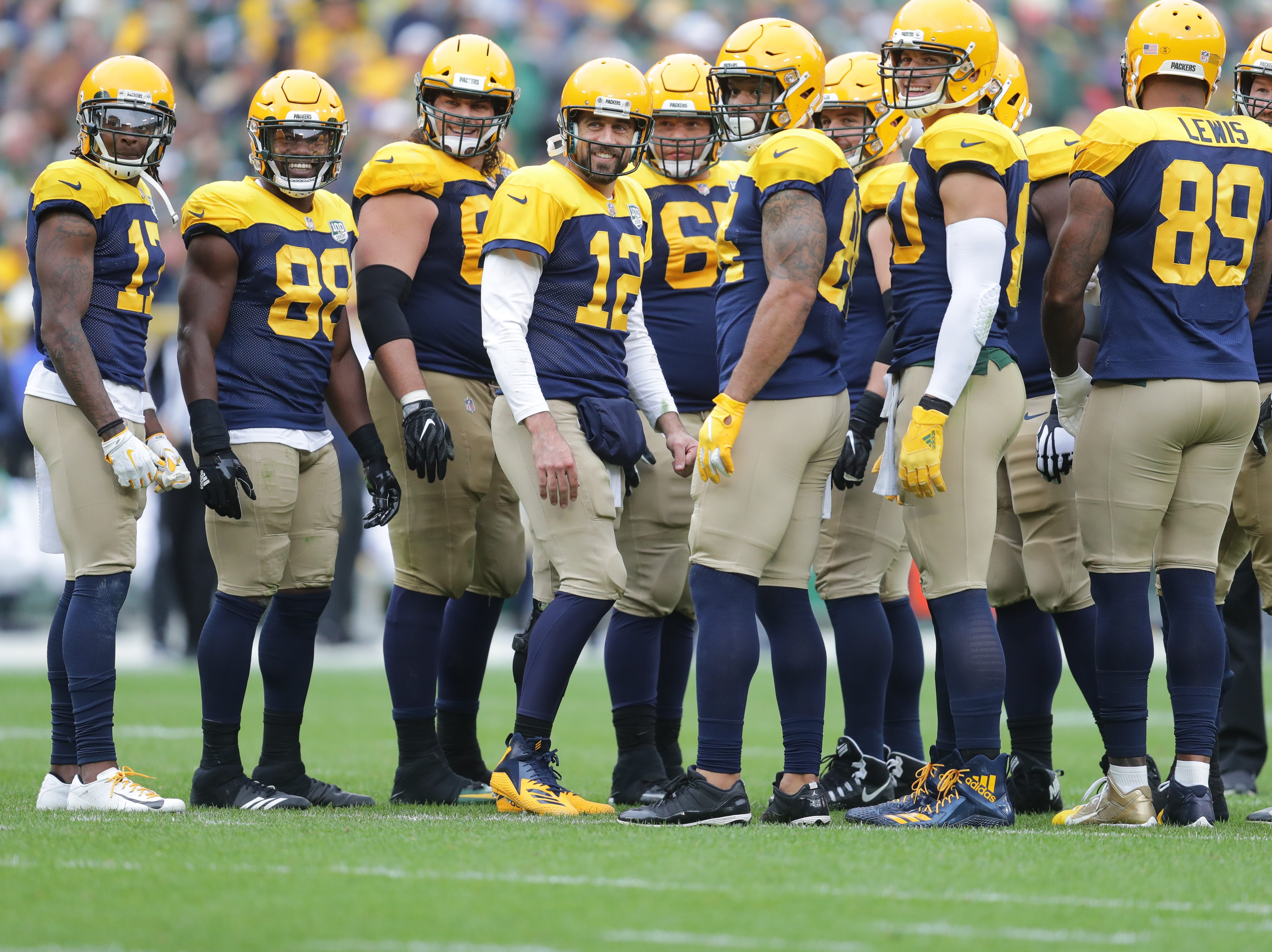 Green Bay Packers quarterback Aaron Rodgers (12) and his teammates look to a group of fans dressed as monks in honor of the Dalai Lama since Aaron Rodgers made a trip to India to meet the  Dalai Lama in April of this year. during the 4th quarter of the Green Bay Packers 22-0 win against the Buffalo Bills at Lambeau Field in Green Bay, Wis. on Sunday, September 30, 2018. Mike De Sisti /USA TODAY NETWORK-Wisconsin