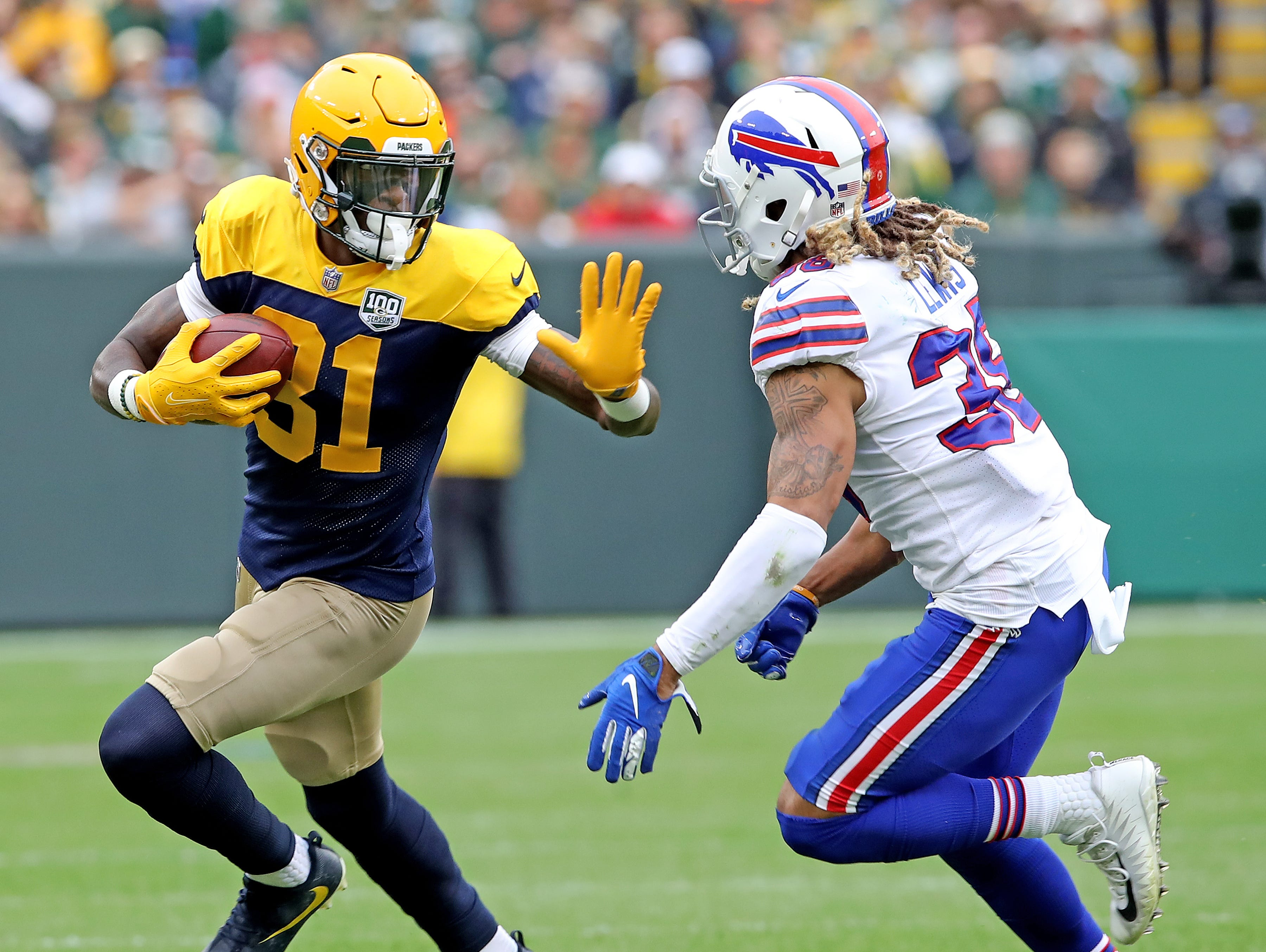 Green Bay Packers wide receiver Geronimo Allison (81) fends off defensive back Ryan Lewis (38) against the Buffalo Bills Sunday September 30, 2018 at Lambeau Field in Green Bay, Wis.
