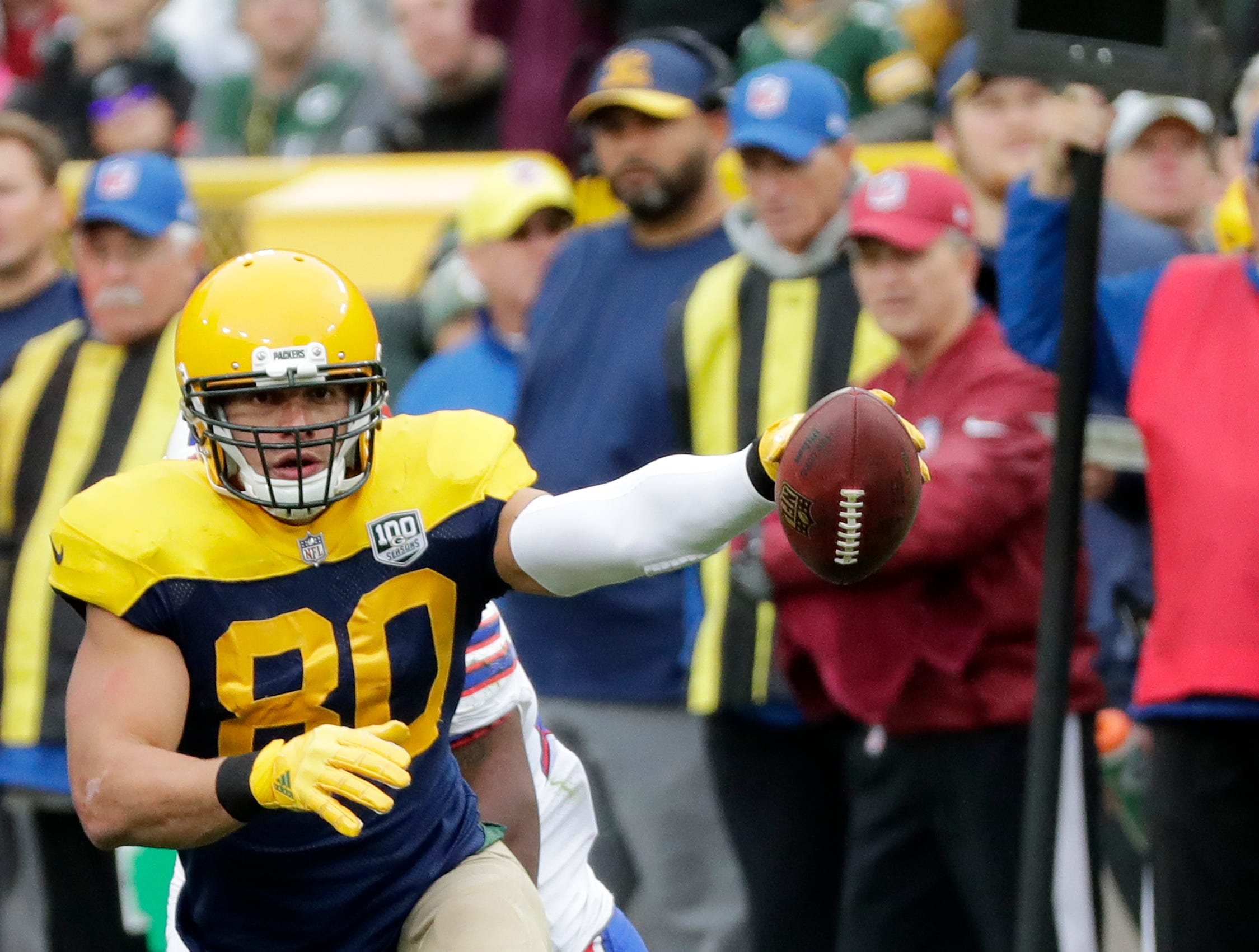 Green Bay Packers tight end Jimmy Graham (80) signals a first down after a catch against the Buffalo Bills in the fourth quarter at Lambeau Field on Sunday, September 30, 2018 in Green Bay, Wis.