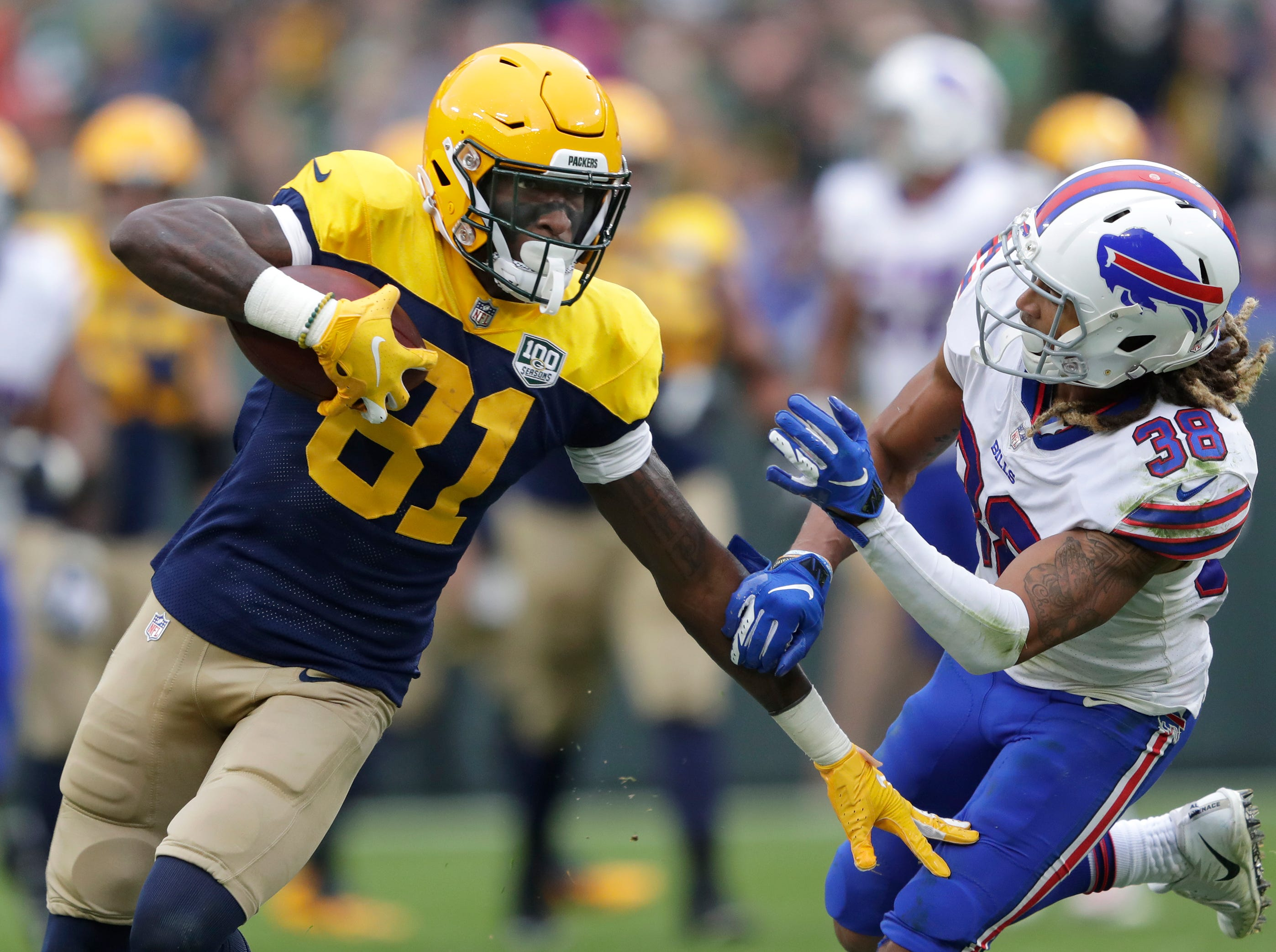 Green Bay Packers wide receiver Geronimo Allison (81) runs after a long gain against Buffalo Bills defensive back Ryan Lewis (38) in the third quarter during their football game Sunday, Sept. 30, 2018, at Lambeau Field in Green Bay, Wis. 