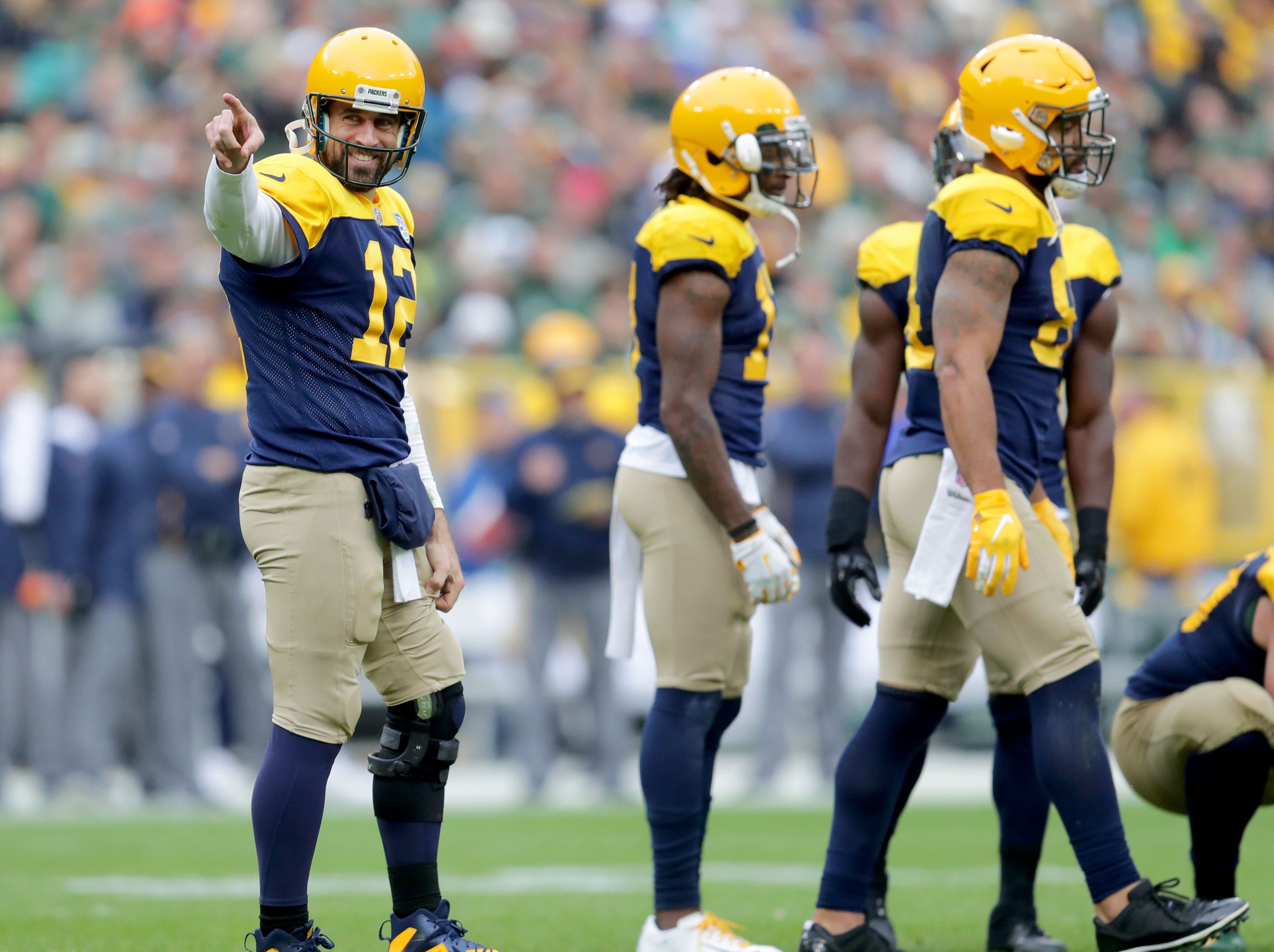Green Bay Packers quarterback Aaron Rodgers (12) looks to a group of fans dressed as monks in honor of the Dalai Lama since Aaron Rodgers made a trip to India to meet the  Dalai Lama in April of this year. during the 4th quarter of the Green Bay Packers 22-0 win against the Buffalo Bills at Lambeau Field in Green Bay, Wis. on Sunday, September 30, 2018. Mike De Sisti /USA TODAY NETWORK-Wisconsin