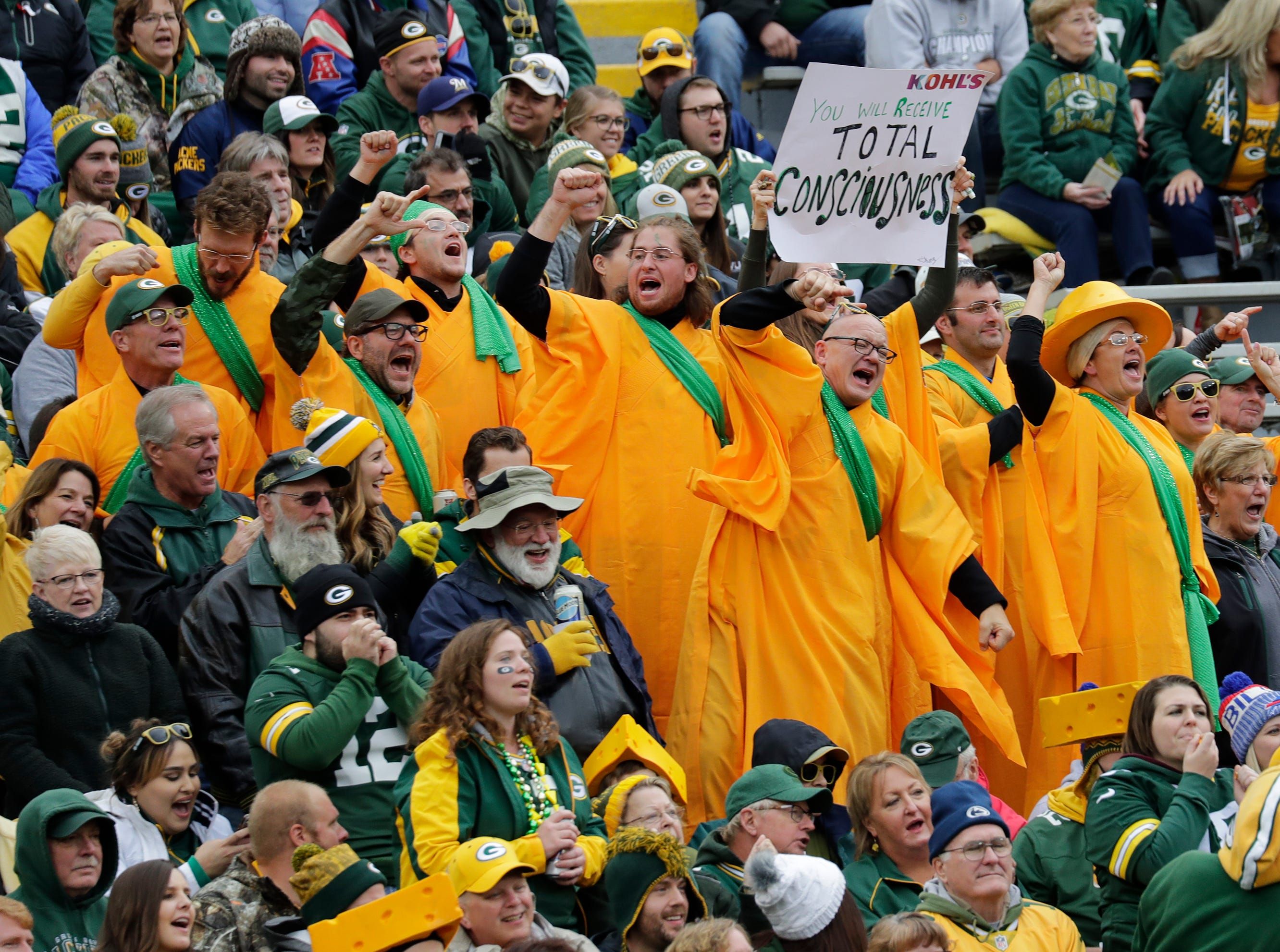 A group of vocal fans catch the attention of Green Bay Packers quarterback Aaron Rodgers (12) late in the fourth quarter against the Buffalo Bills during their football game Sunday, Sept. 30, 2018, at Lambeau Field in Green Bay, Wis. 