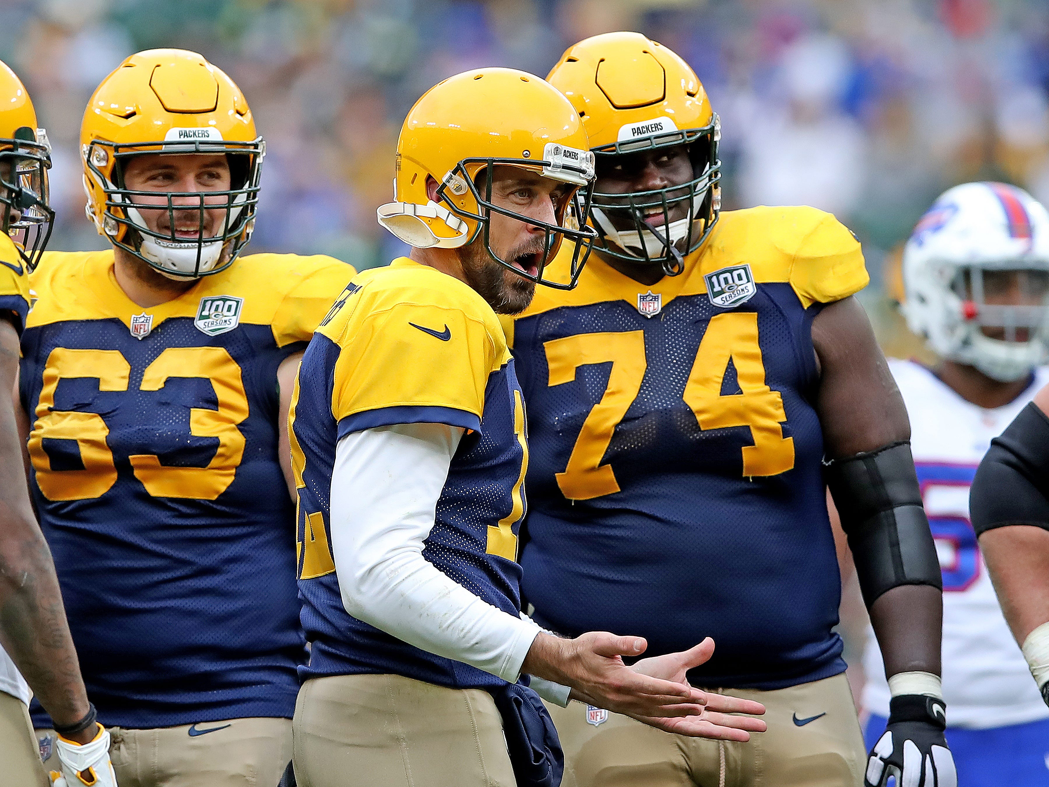 Green Bay Packers quarterback Aaron Rodgers (12) reacts to a group in the stands against the Buffalo Bills Sunday September 30, 2018 at Lambeau Field in Green Bay, Wis.