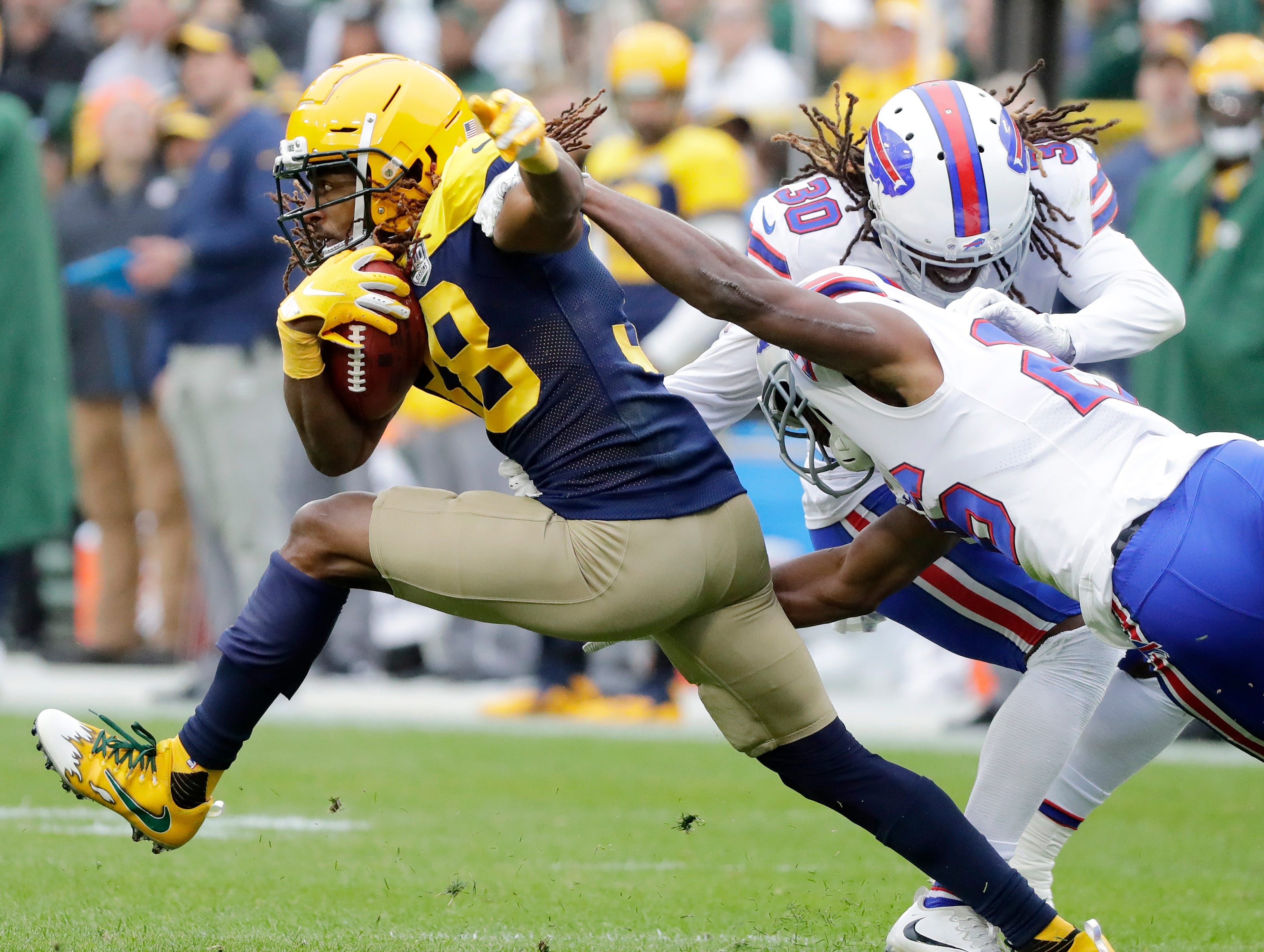 Green Bay Packers defensive back Tramon Williams (38) returns a punt against the Buffalo Bills in the third quarter at Lambeau Field on Sunday, September 30, 2018 in Green Bay, Wis.