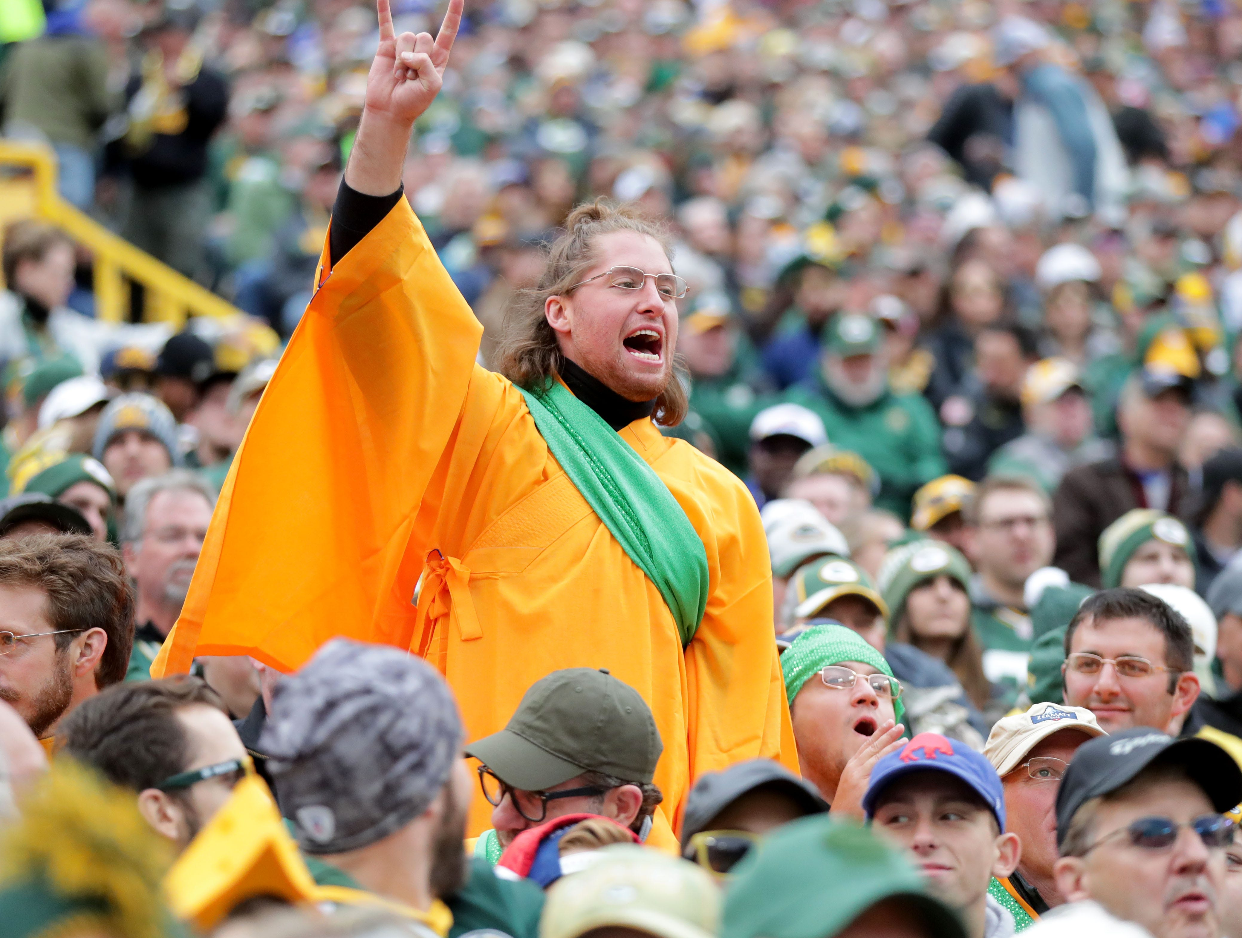 A fan dressed as a monk in honor of the Dalai Lama cheers in the crowd since Aaron Rodgers made a trip to India to meet the  Dalai Lama in April of this year. This was during the first quarter of the Green Bay Packers game against the Buffalo Bills at Lambeau Field in Green Bay, Wis. on Sunday, September 30, 2018. Mike De Sisti /USA TODAY NETWORK-Wisconsin