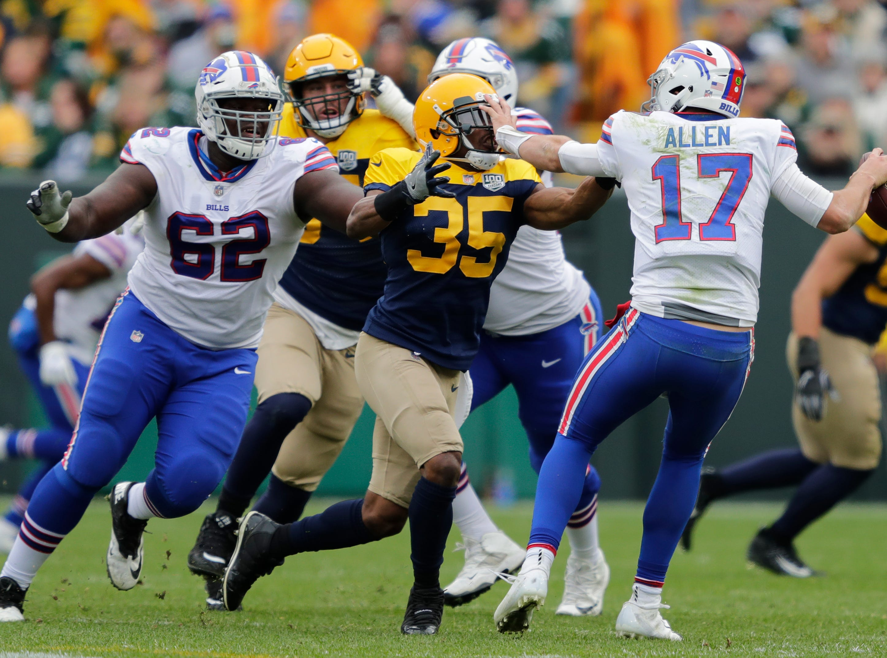 Green Bay Packers defensive back Jermaine Whitehead (35) pressures Buffalo Bills quarterback Josh Allen (17) late in the fourth quarter during their football game Sunday, Sept. 30, 2018, at Lambeau Field in Green Bay, Wis. 