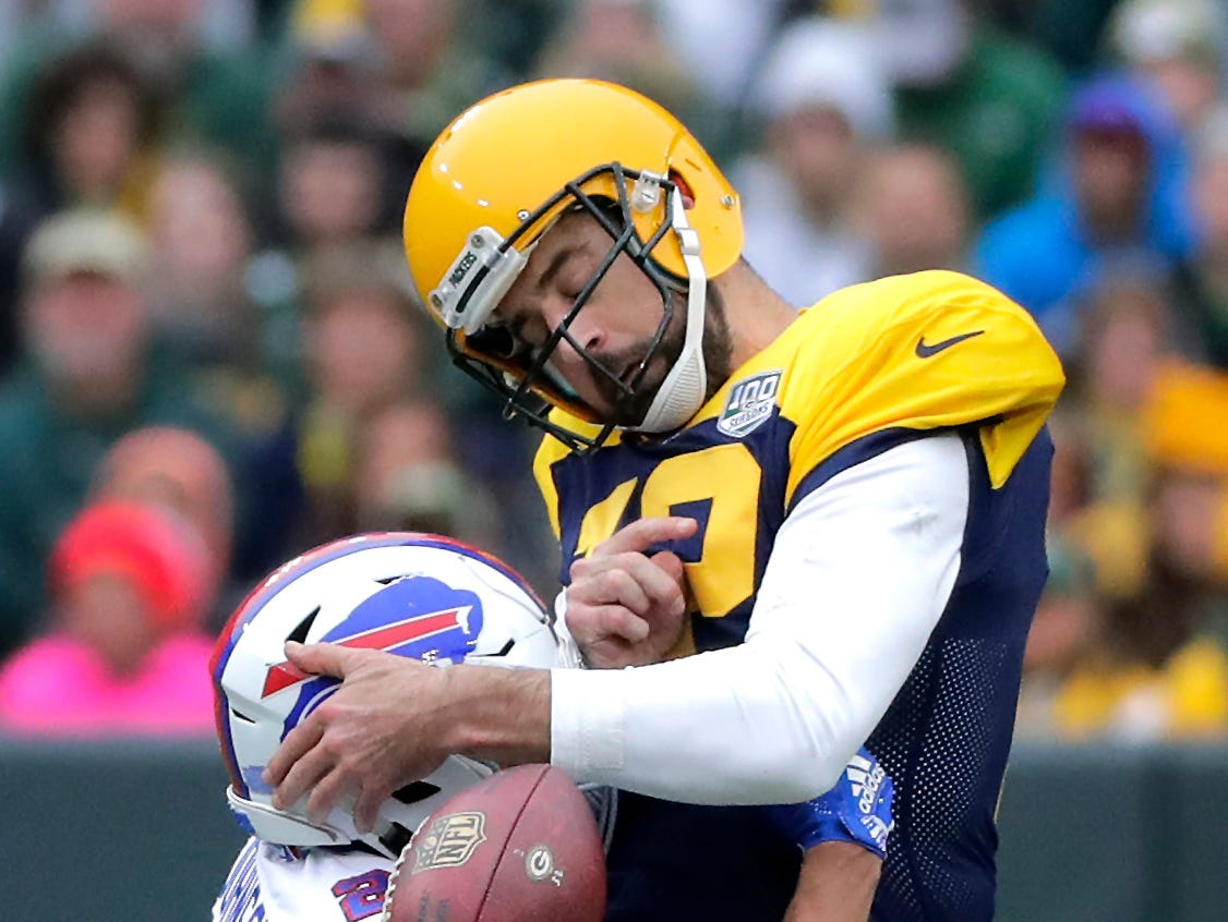 Green Bay Packers quarterback Aaron Rodgers fumbles as he is sacked by Buffalo Bills cornerback Taron Johnson in the second half on Sunday, September 30, 2018, at Lambeau Field in Green Bay, Wis.