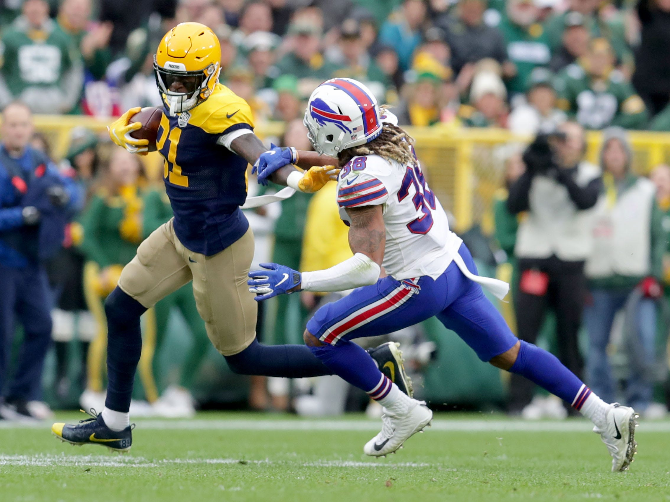 Green Bay Packers wide receiver Davante Adams (17) avoids a tackle by Buffalo Bills defensive back Ryan Lewis (38) during the 3rd quarter of the Green Bay Packers 22-0 win against the Buffalo Bills at Lambeau Field in Green Bay, Wis. on Sunday, September 30, 2018. Mike De Sisti /USA TODAY NETWORK-Wisconsin