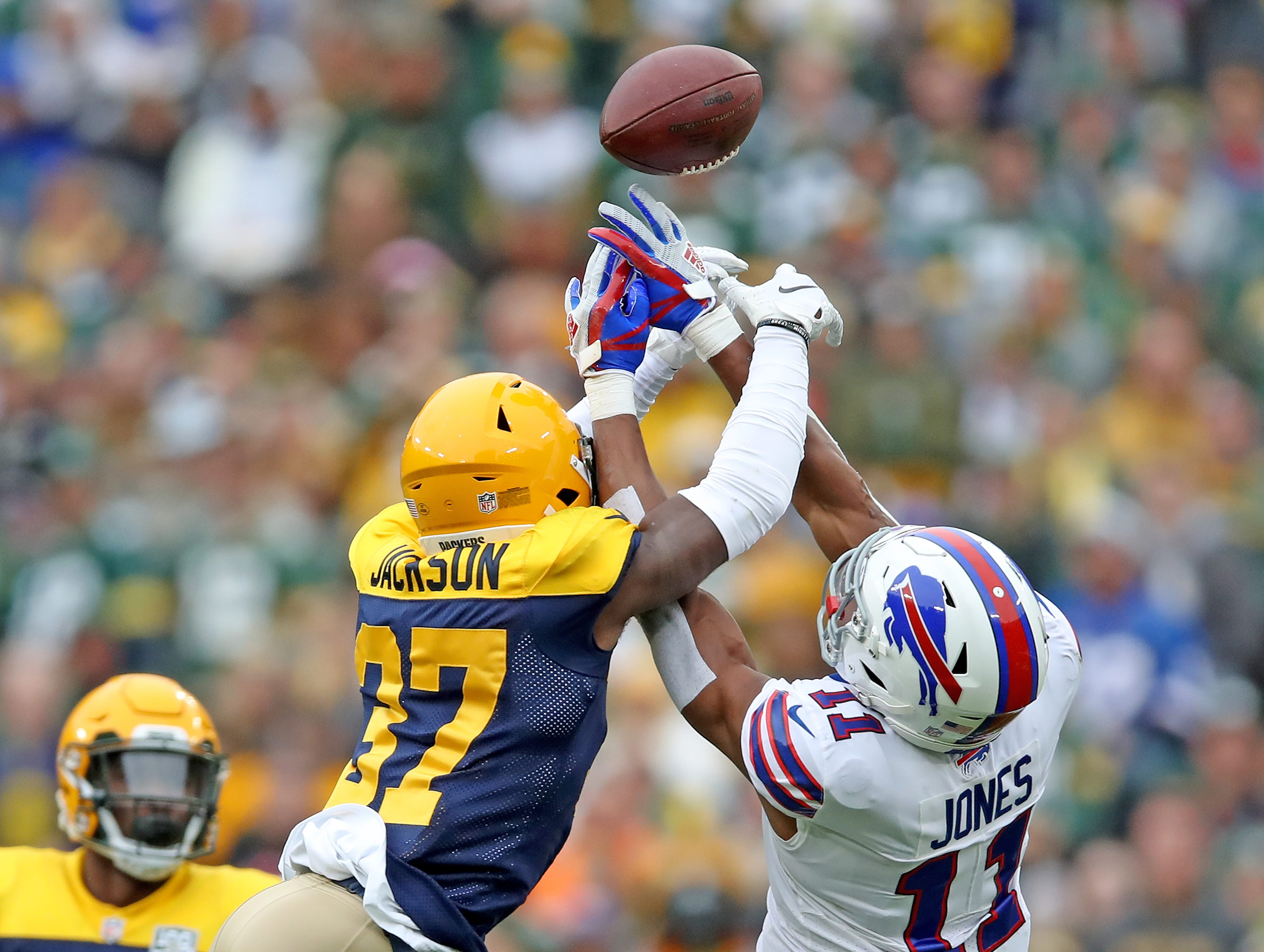 Green Bay Packers cornerback Josh Jackson (37) breaks up a pass to wide receiver Zay Jones (11) against the Buffalo Bills Sunday September 30, 2018 at Lambeau Field in Green Bay, Wis.