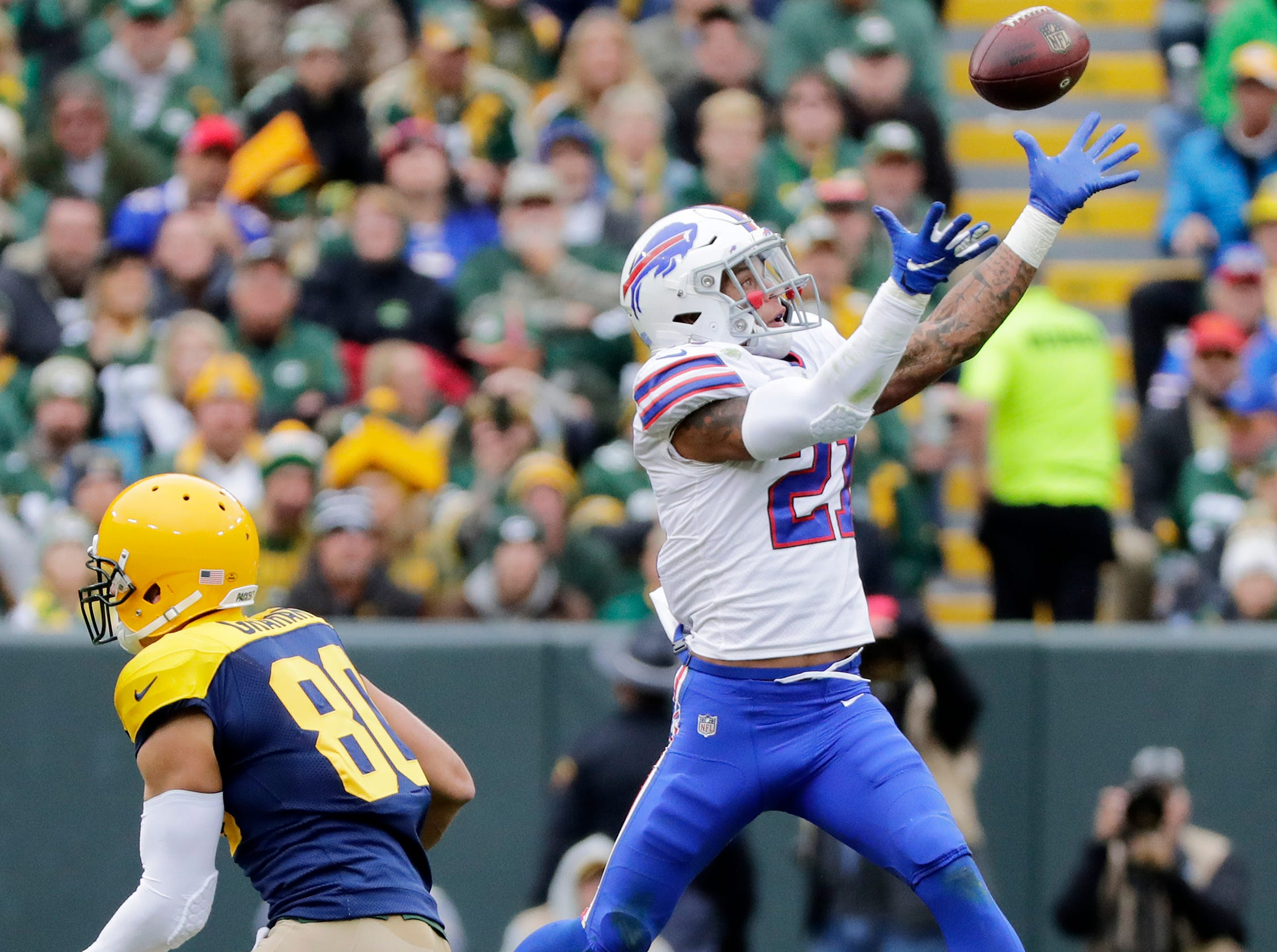Buffalo Bills defensive back Jordan Poyer (21) intercepts a pass intended for Green Bay Packers tight end Jimmy Graham (80) in the second quarter at Lambeau Field on Sunday, September 30, 2018 in Green Bay, Wis.