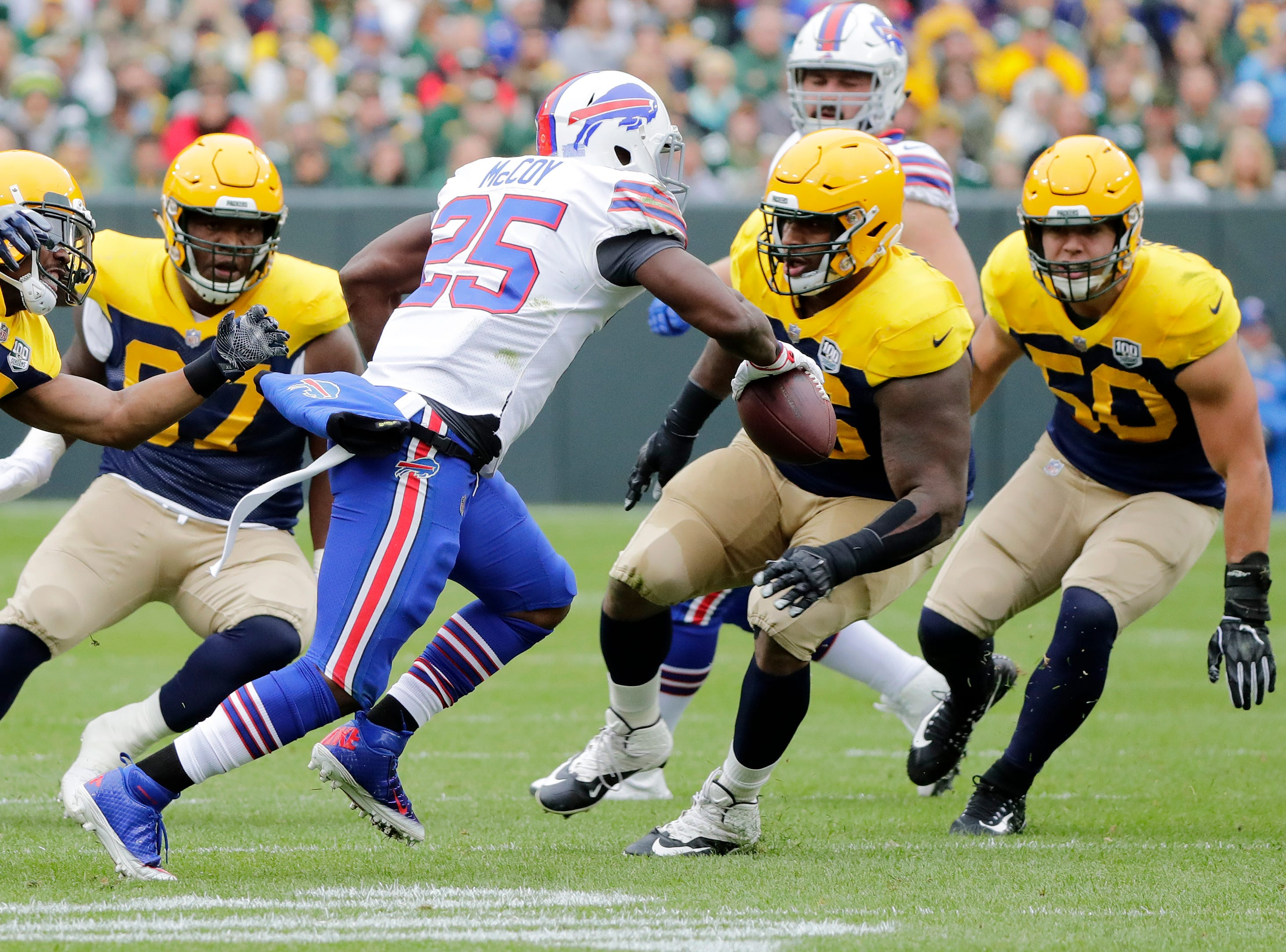 Buffalo Bills running back LeSean McCoy (25) is surrounded by a group of Green Bay Packers players in the first half at Lambeau Field on Sunday, September 30, 2018 in Green Bay, Wis.
