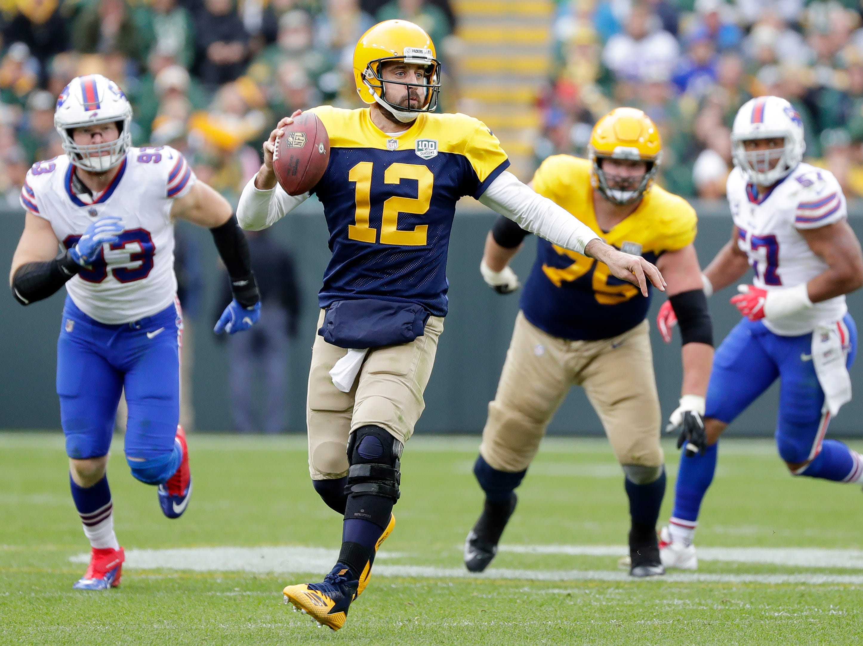 Green Bay Packers quarterback Aaron Rodgers (12) scrambles against the Buffalo Bills in the fourth quarter at Lambeau Field on Sunday, September 30, 2018 in Green Bay, Wis.